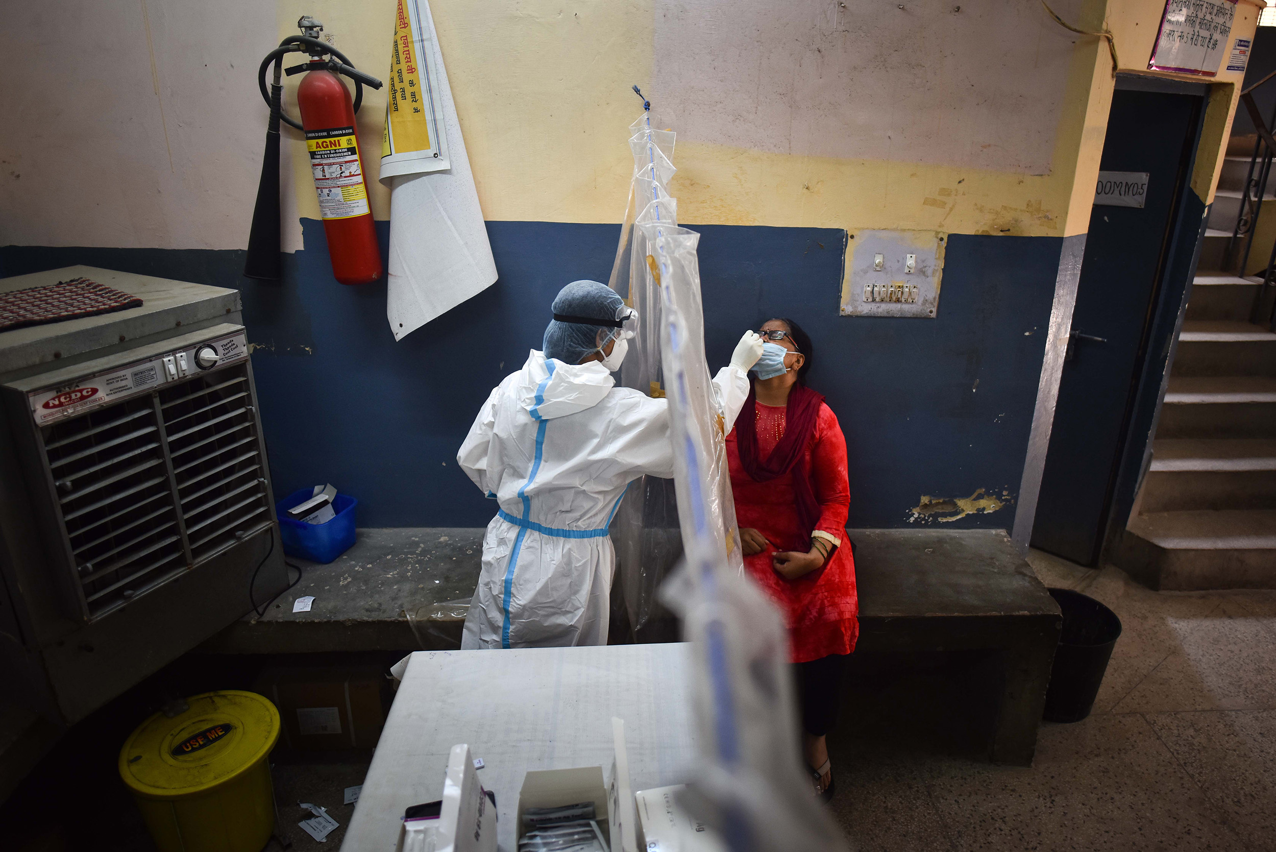 A health worker collects a swab sample at a coronavirus testing center, in Baljeet Nagar, on September 5.