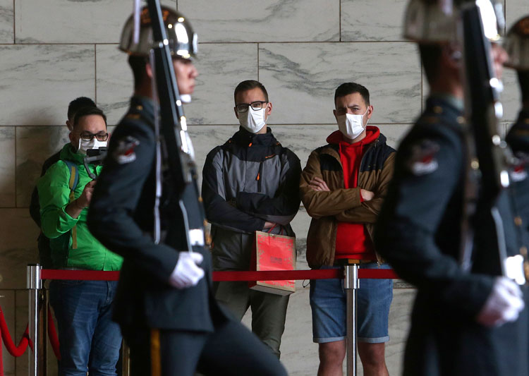 People wear face masks to protect against the spread of the new coronavirus at Chiang Kai-shek Memorial Hall in Taipei, Taiwan, Thursday, February 27.