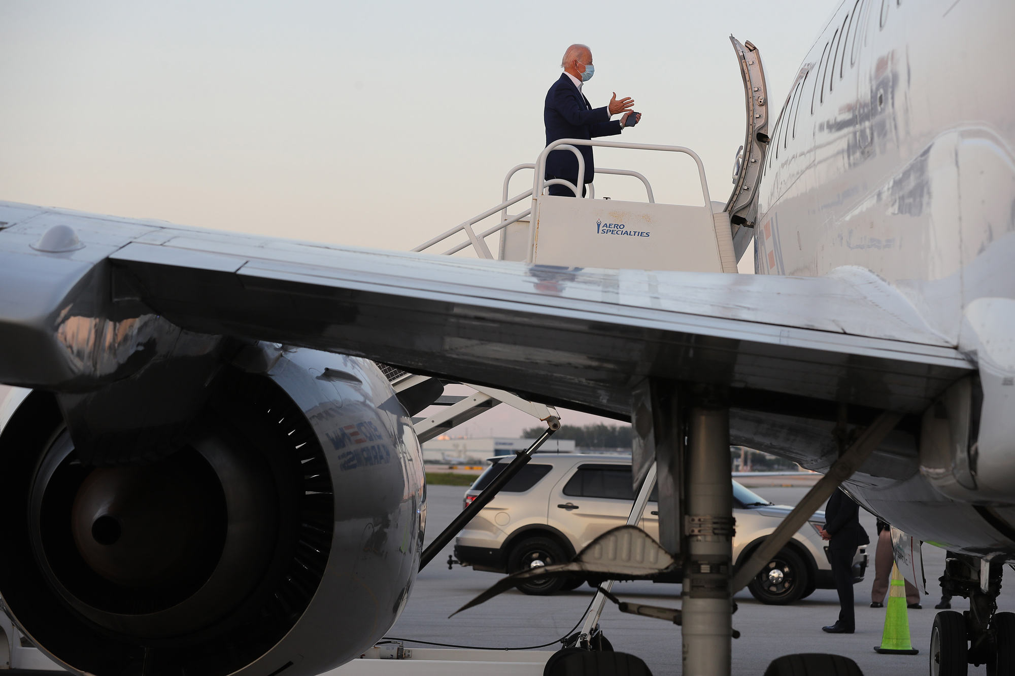 Democratic presidential candidate Joe Biden boards his campaign plane at Fort Lauderdale-Hollywood International Airport October 13 in Fort Lauderdale, Florida.