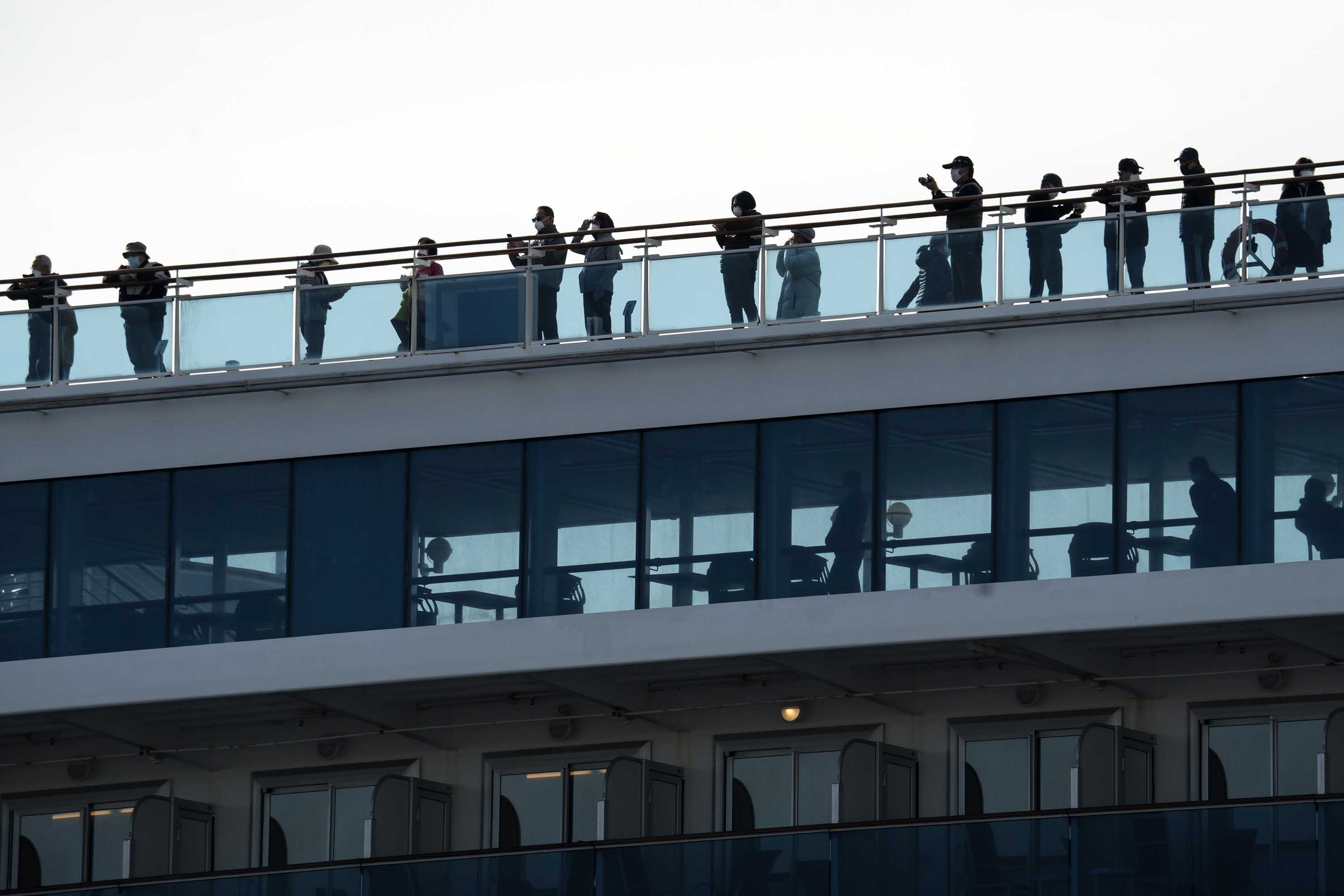 Passengers are seen on board the Diamond Princess cruise ship in Yokohama, Japan, on February 12.