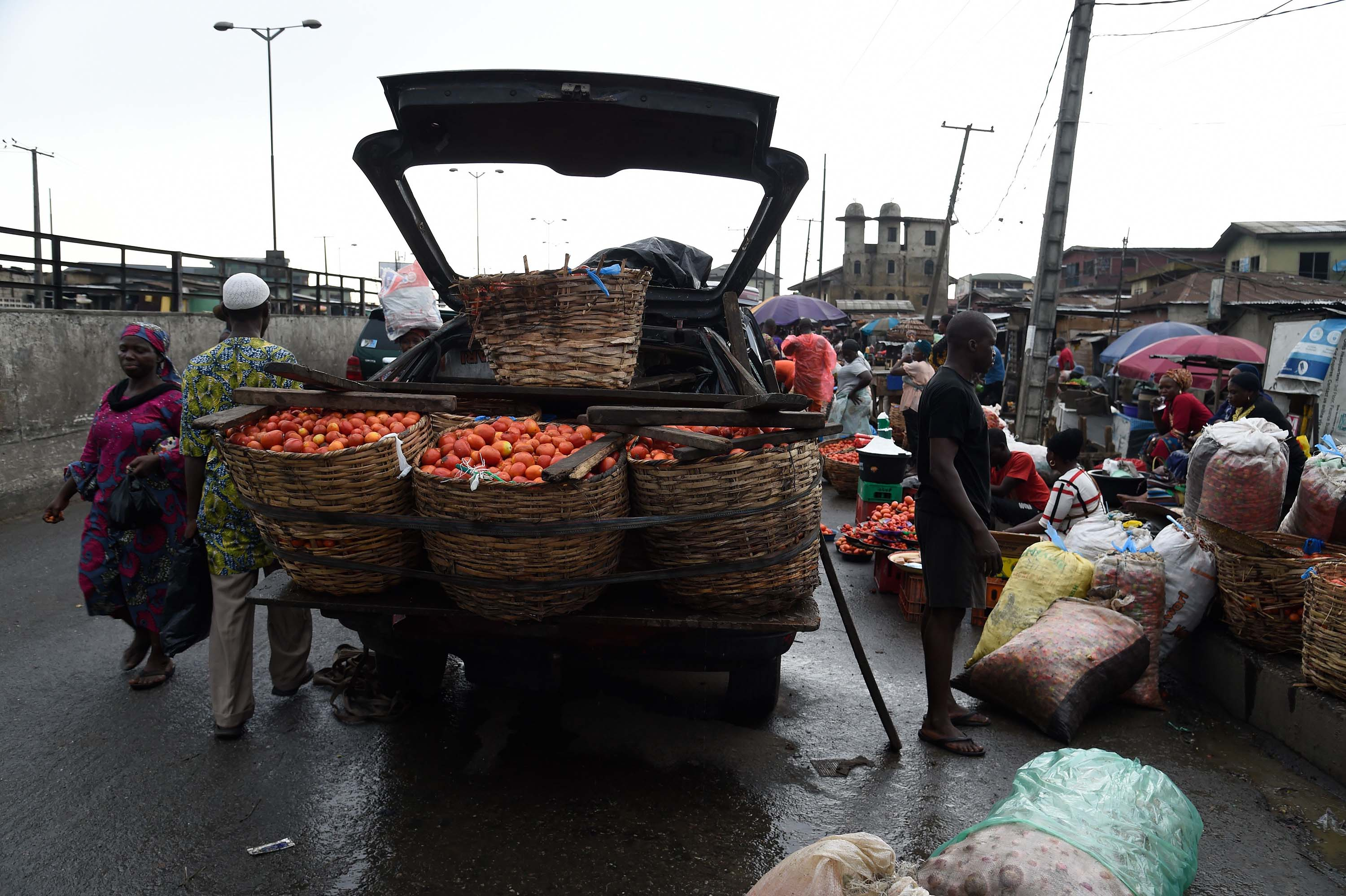 Vendors sell food at a market in Lagos, Nigeria, on April 6.
