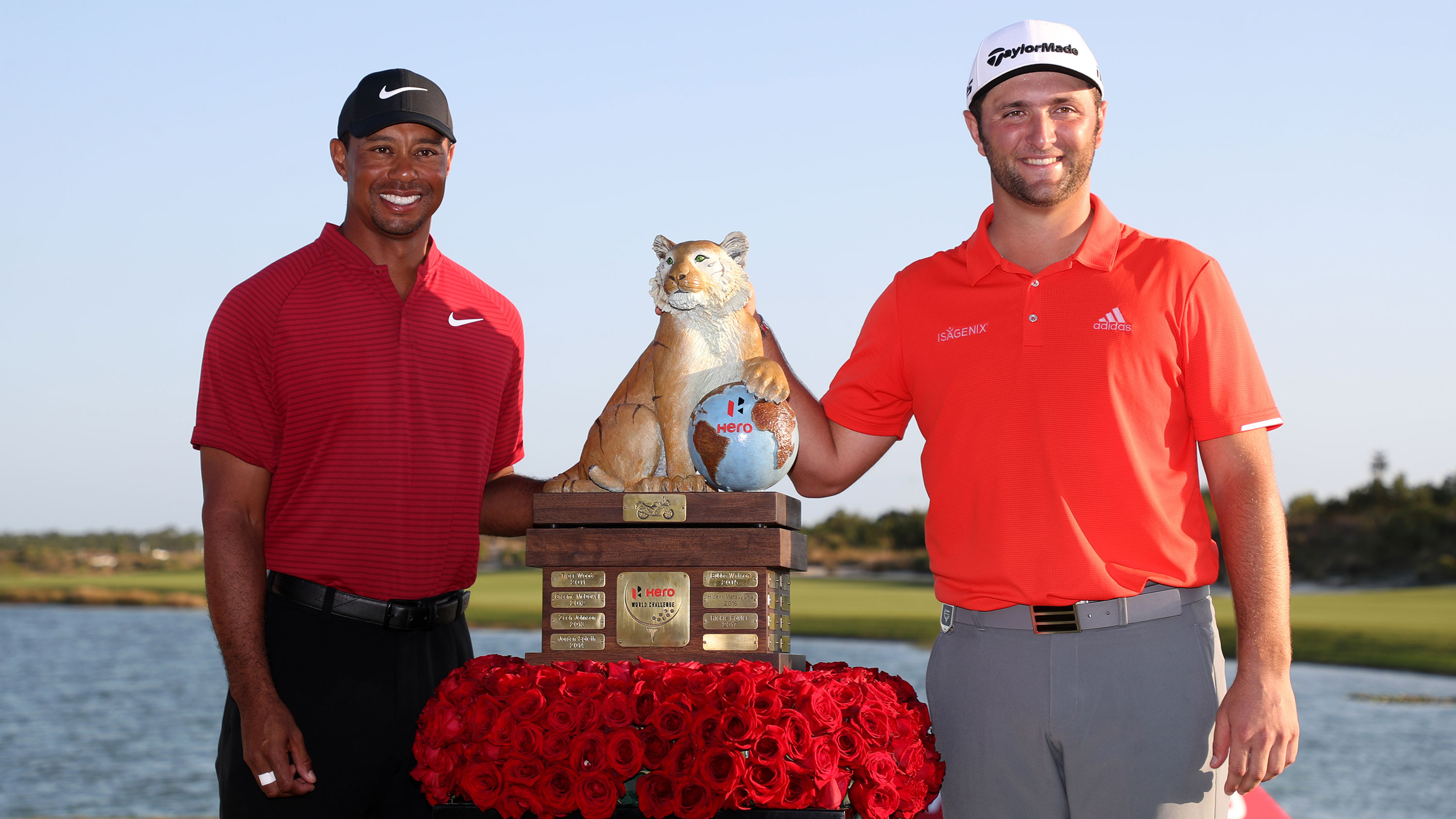 Jon Rahm poses with Tiger Woods after winning the Hero World Challenge in 2018.