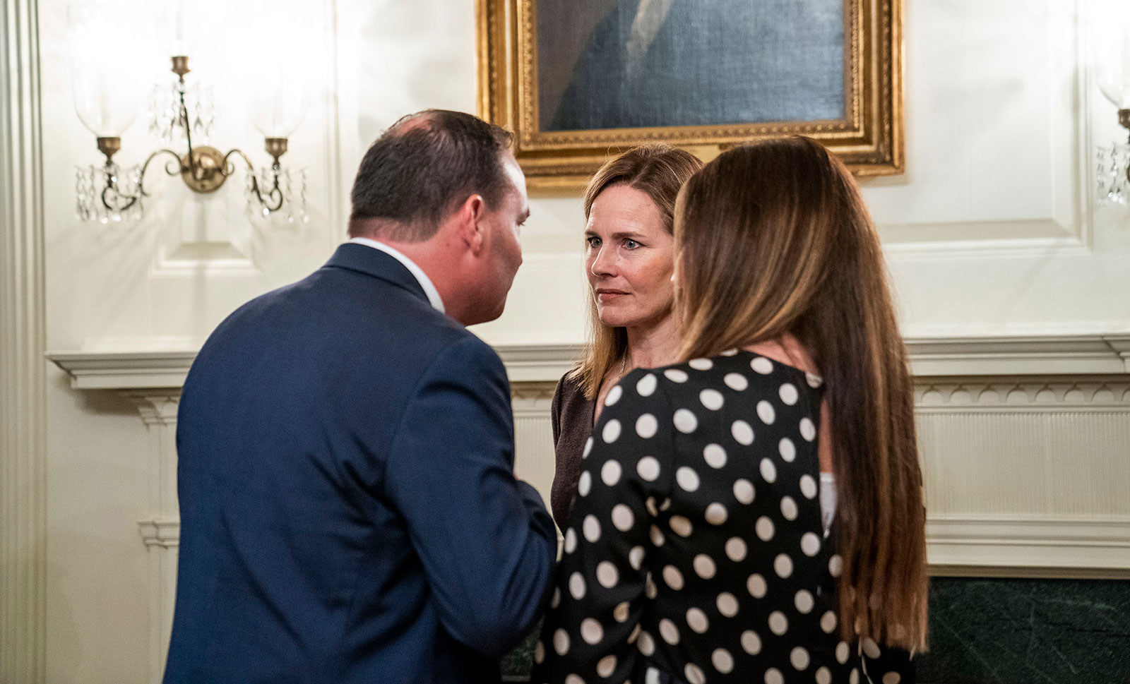 US Sen. Mike Lee and his wife, Sharon, chat with Barrett. Lee has tested positive since the reception.