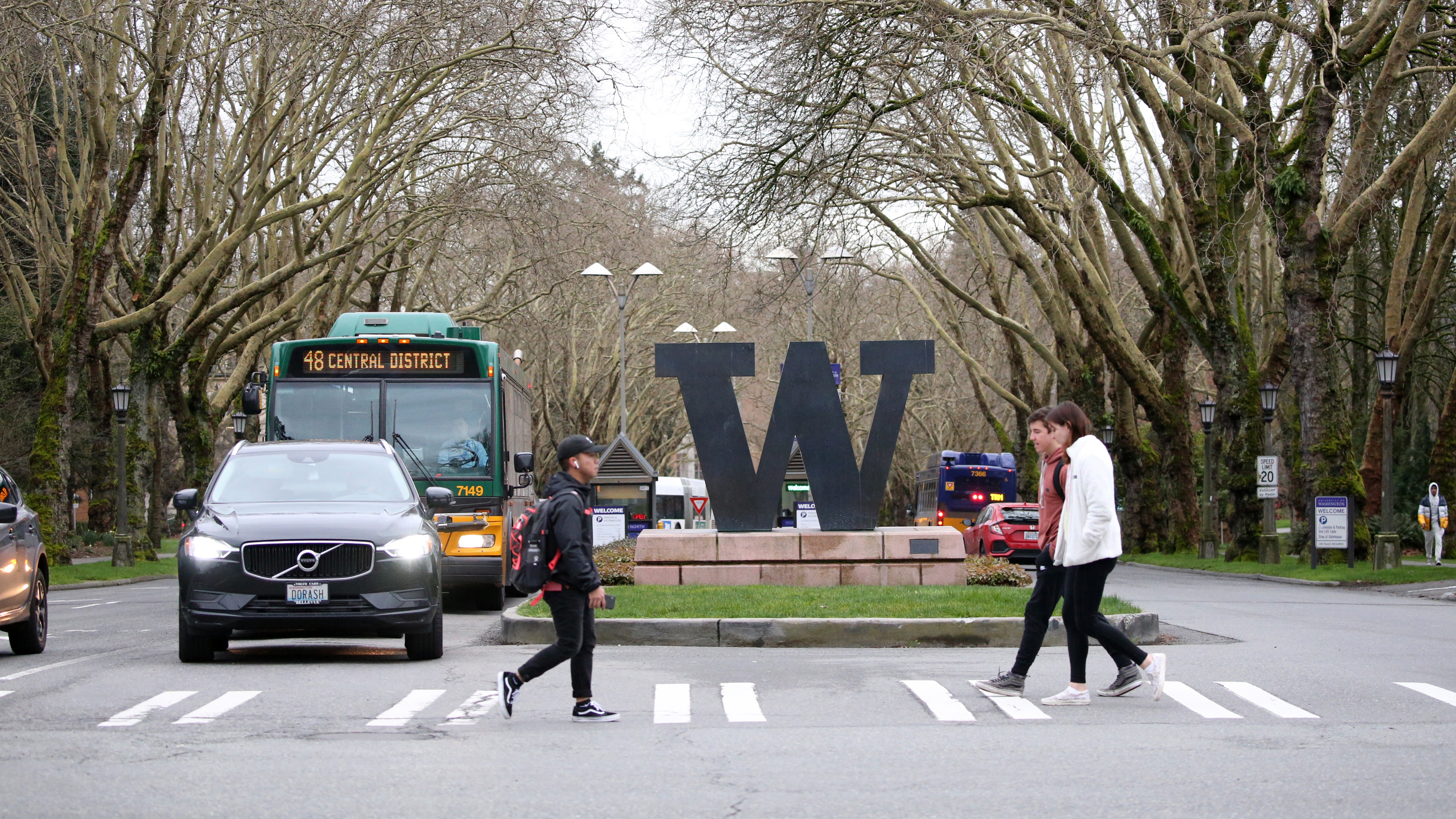 Students walk around the University of Washington campus for the last day of in-person classes on March 6 in Seattle. The university closed on Monday as a precaution against coronavirus.