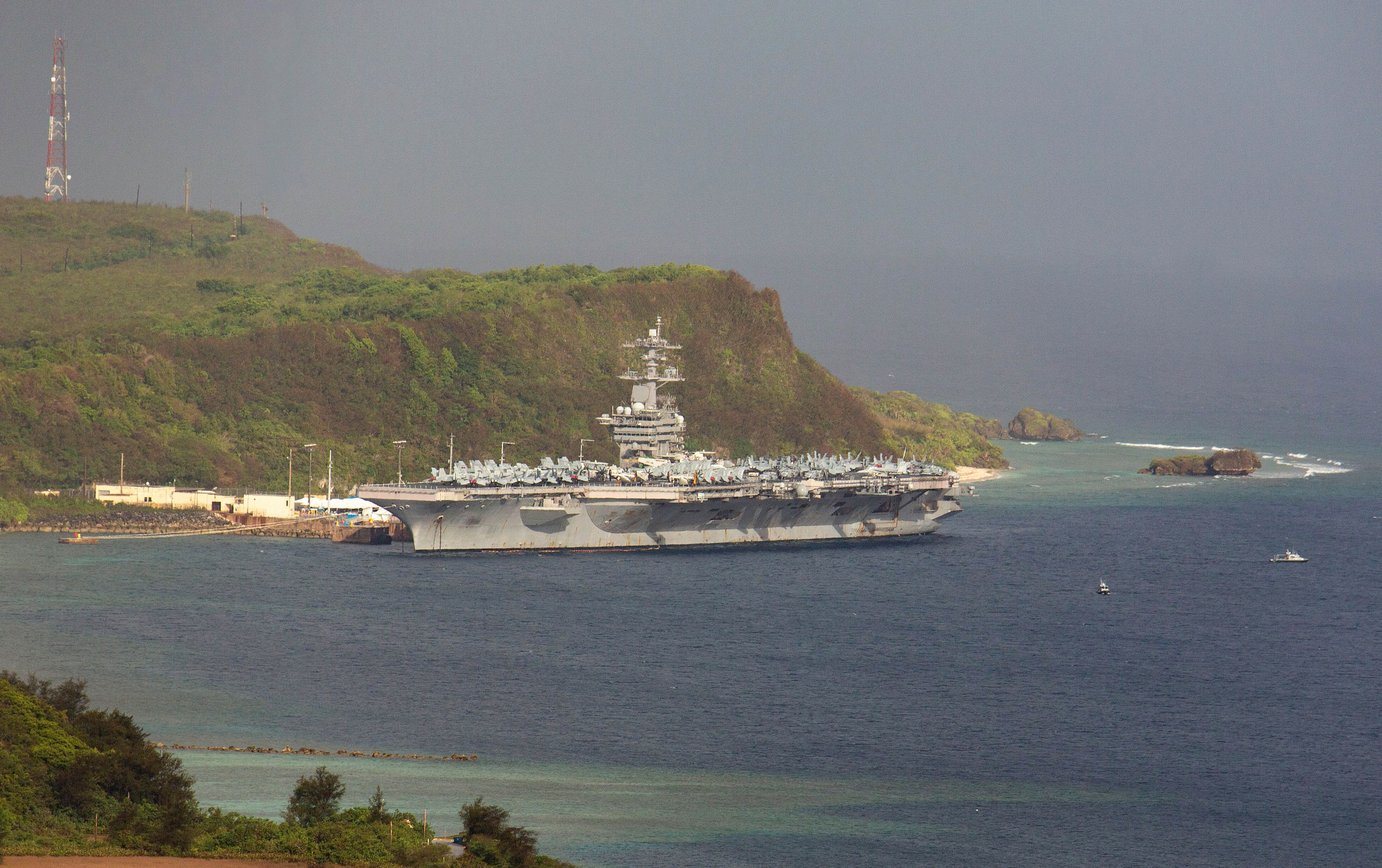 The aircraft carrier USS Theodore Roosevelt is docked at Naval Base Guam in Apra Harbor on April 27.