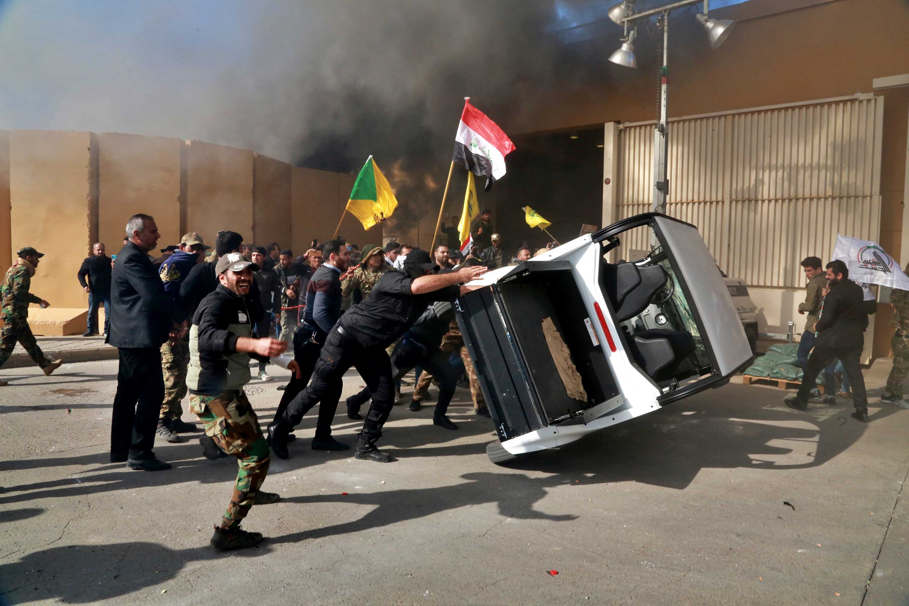 Protesters damage property inside the US Embassy compound in the Iraqi capital, Baghdad.