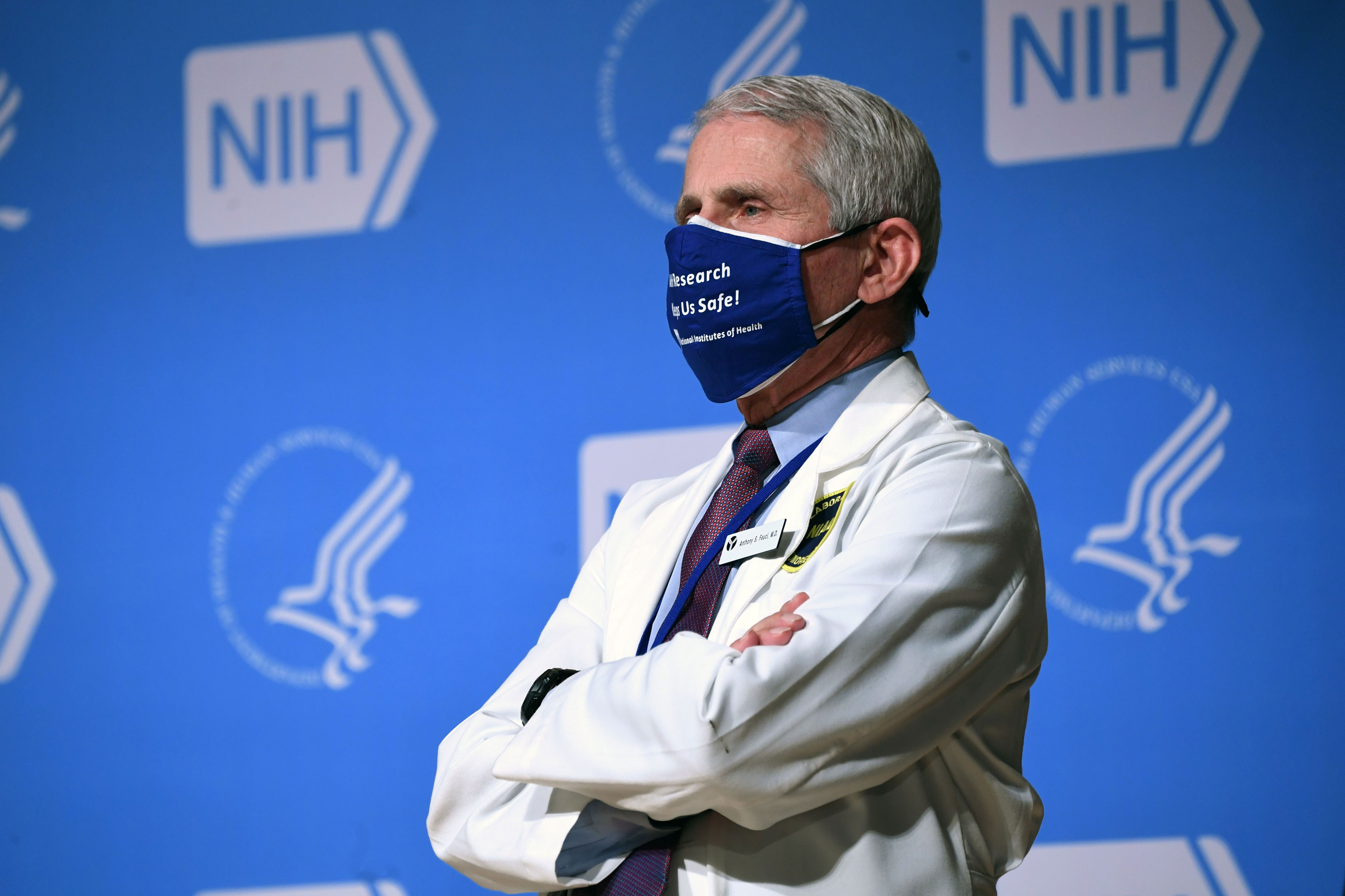 Dr. Anthony Fauci listens to US President Joe Biden, out of frame, during a visit to the National Institutes of Health in Bethesda, Maryland, on February 11.