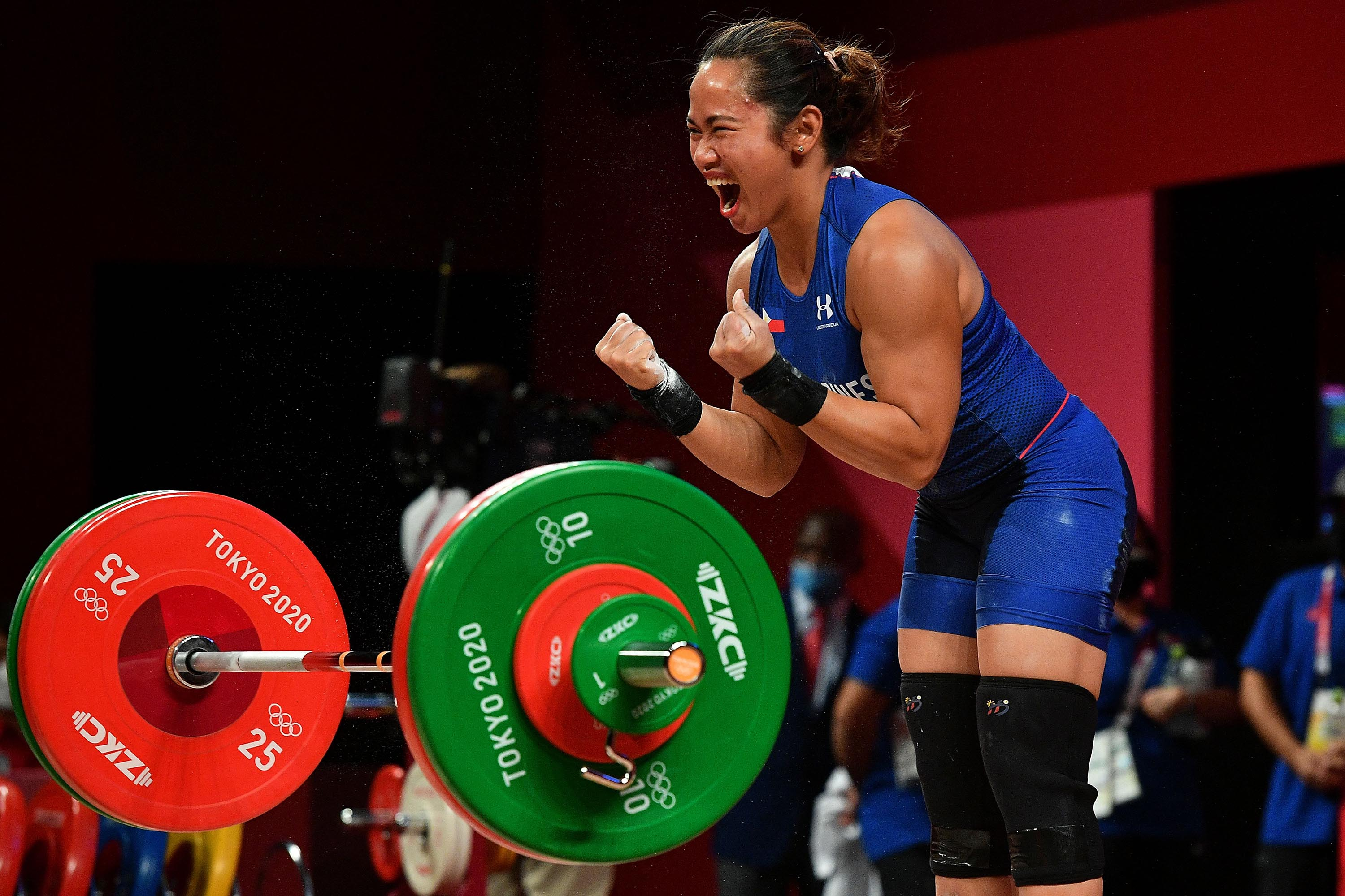 The Philippines' Hidilyn Diaz reacts after winning Olympic gold in the 55-kilogram weightlifting competition on Monday, July 26.