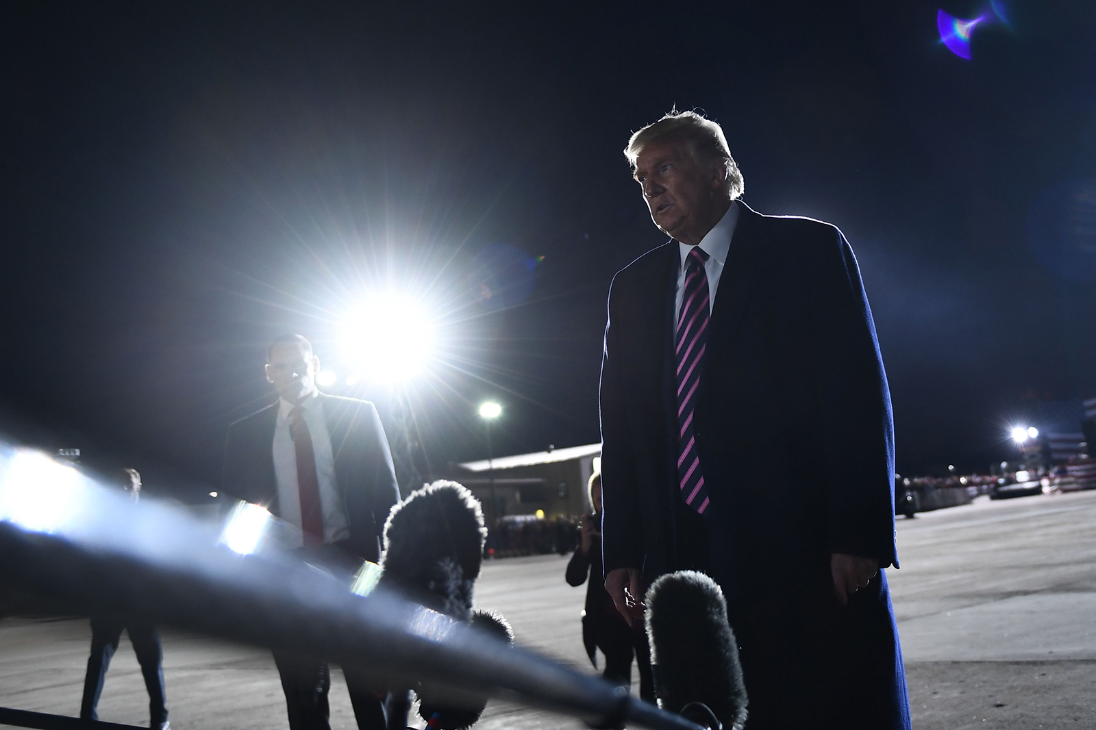 "President Donald Trump reacts to the news of the death of Supreme Court Justice Ruth Bader Ginsburg on the tarmac of Bemidji Regional Airport after addressing supporters during a ""Great American Comeback"" rally at in Bemidji, Minnesota, on September 18."
