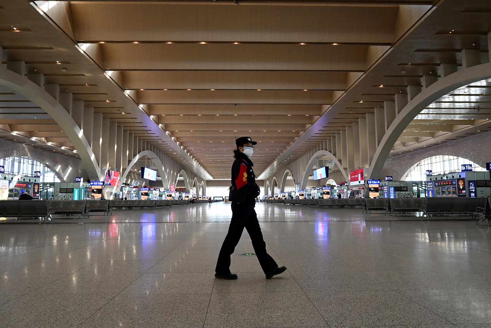 A police patrol is seen walking in an empty railway station in Shijiazhaung, China, on January 7.
