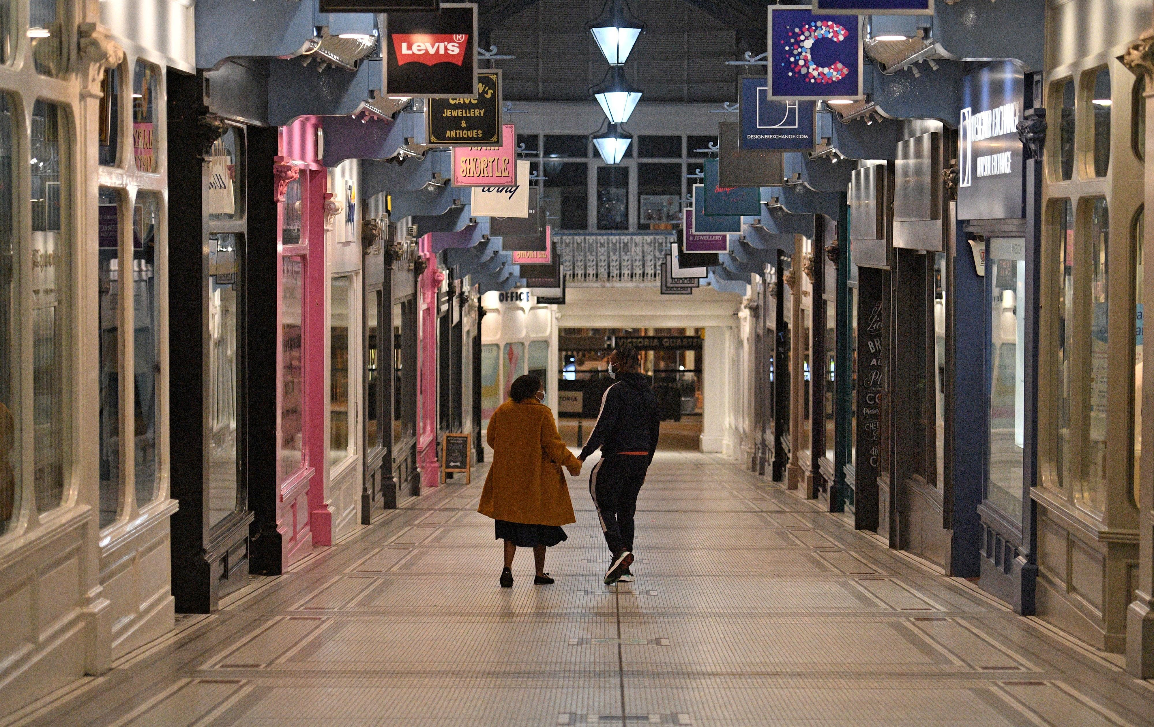 People walk through an empty shopping center in Leeds, England, on November 4.