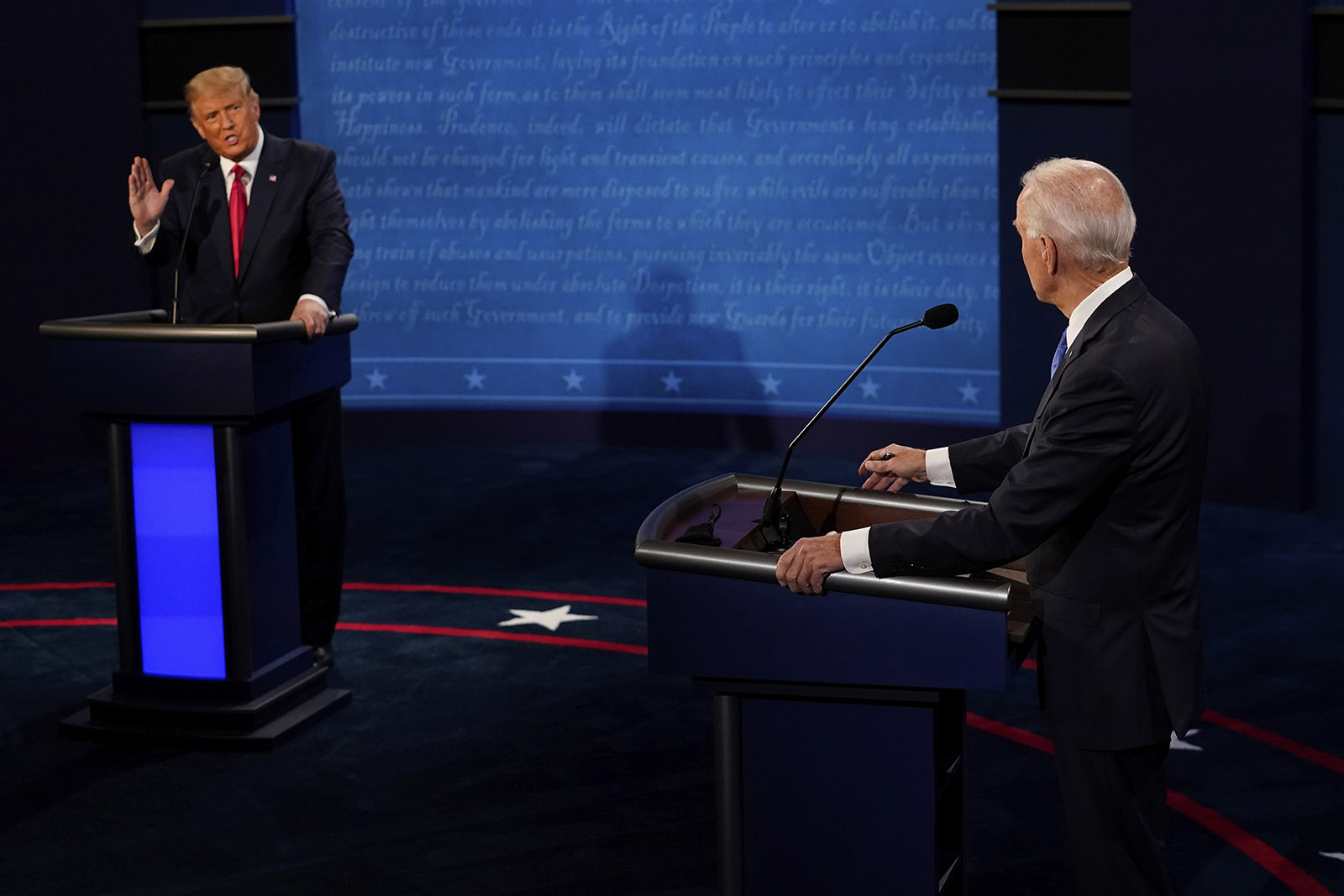 President Donald Trump answers a question as Democratic presidential candidate Joe Biden listens during the second and final presidential debate on Thursday in Nashville.
