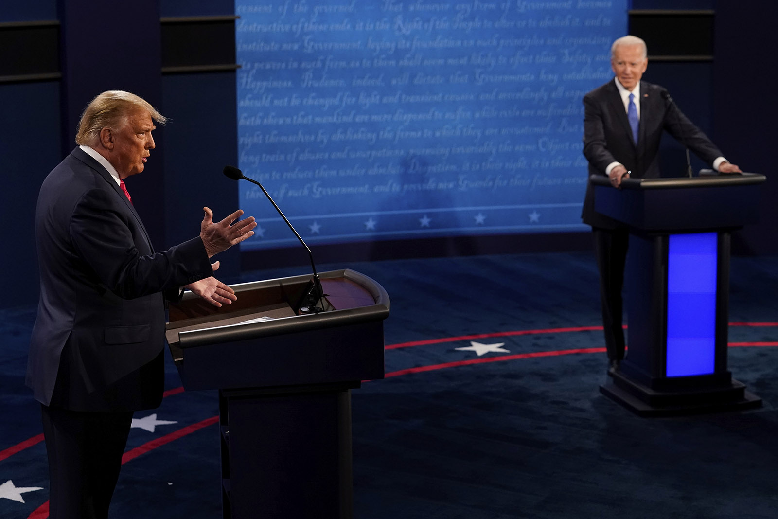 President Donald Trump answers a question as Democratic presidential candidate former Vice President Joe Biden listens during the second and final presidential debate on Thursday in Nashville.
