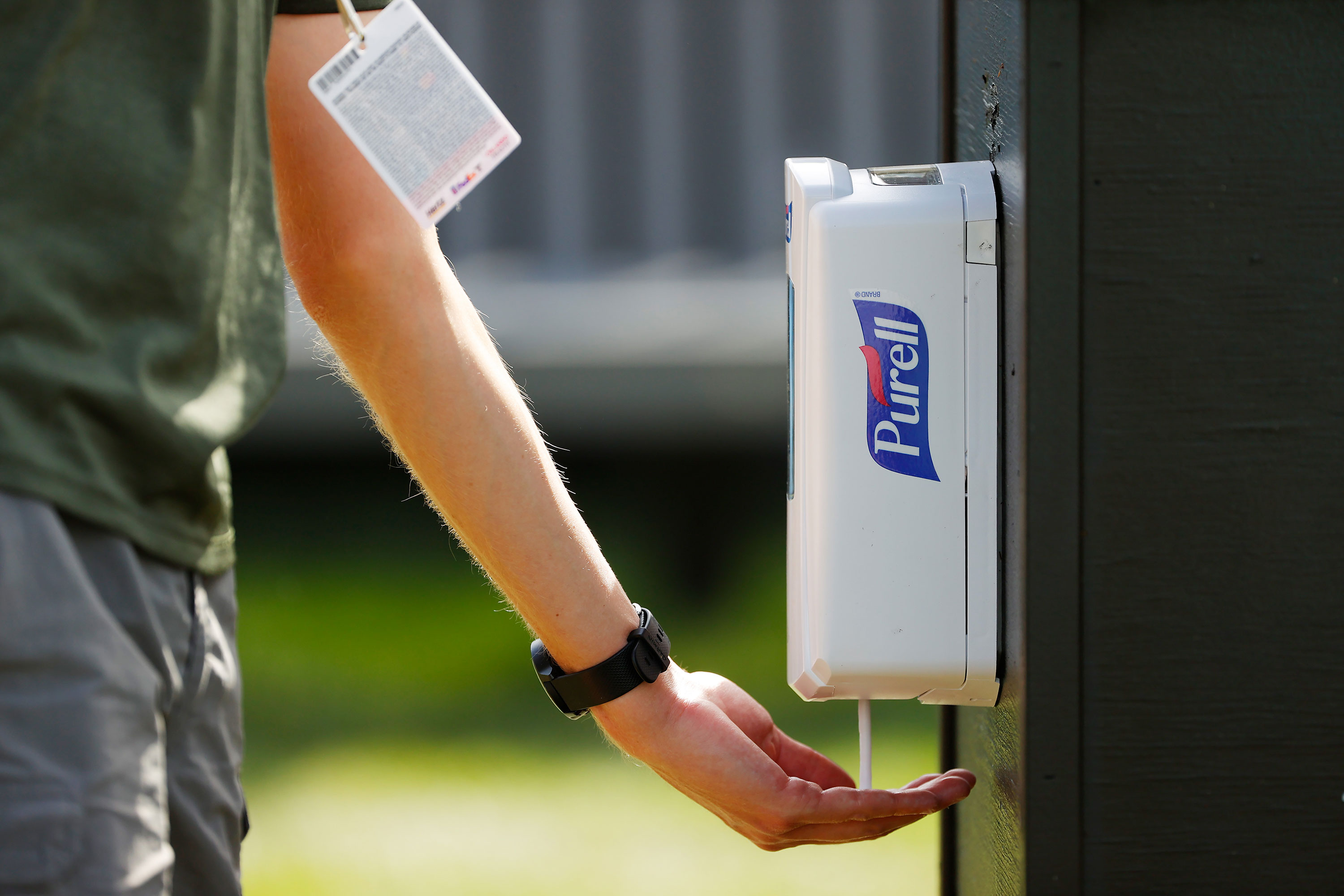 A person uses Purell hand sanitizer during the first round of the Arnold Palmer Invitational in Orlando, Florida, on March 5.
