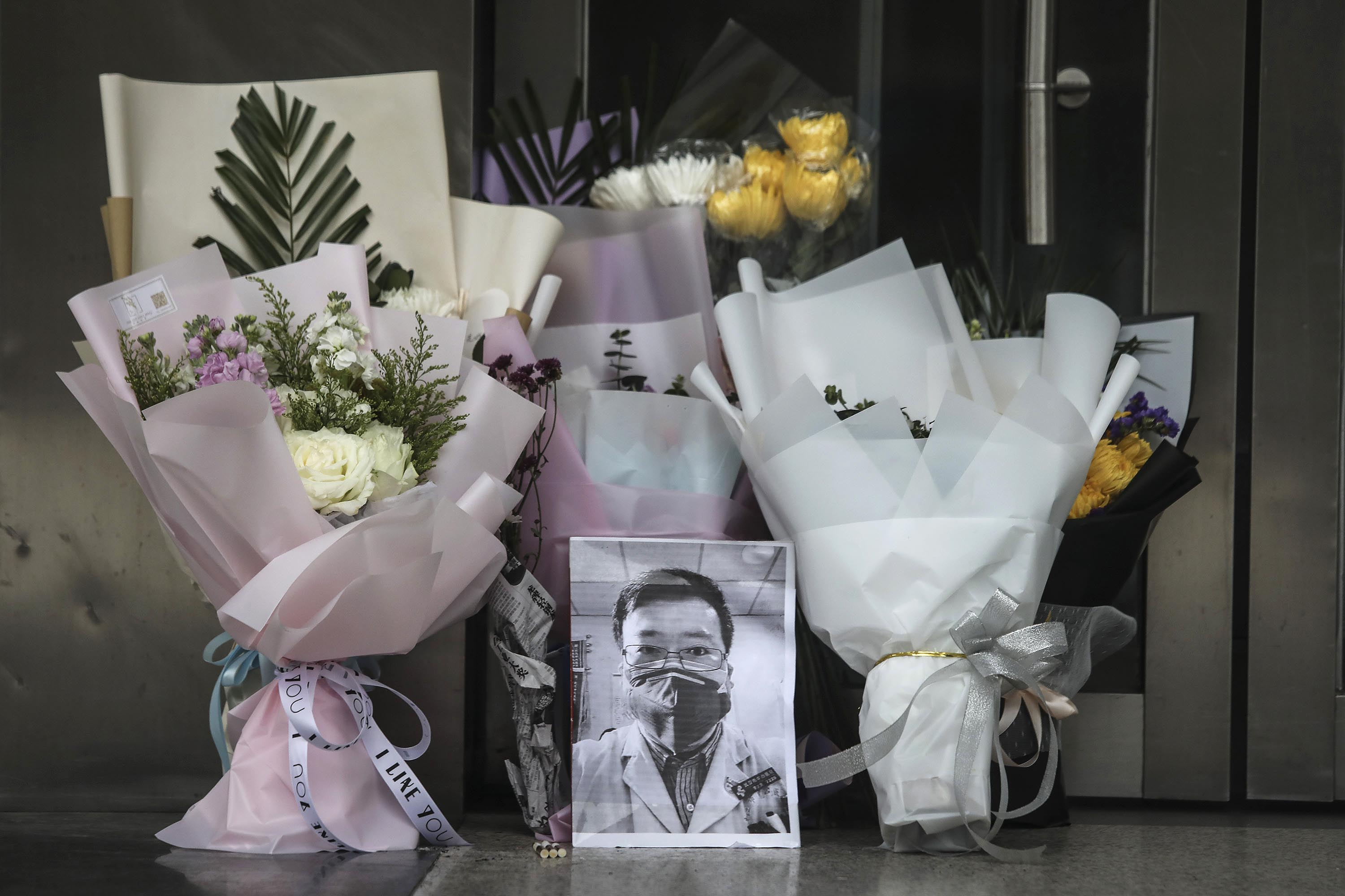 A portrait of Dr. Li Wenliang is left at Li's hospital in Wuhan on February 7, following his death.