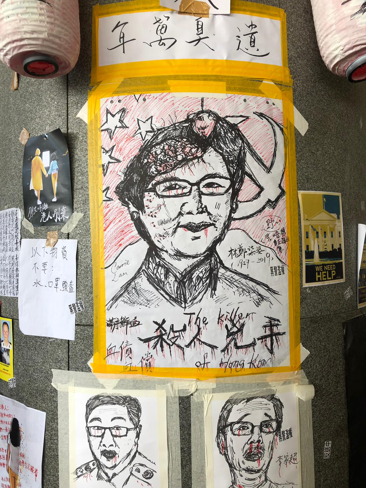 Posters near Hong Kong's government headquarters satirize city officials, including Chief Executive Carrie Lam.