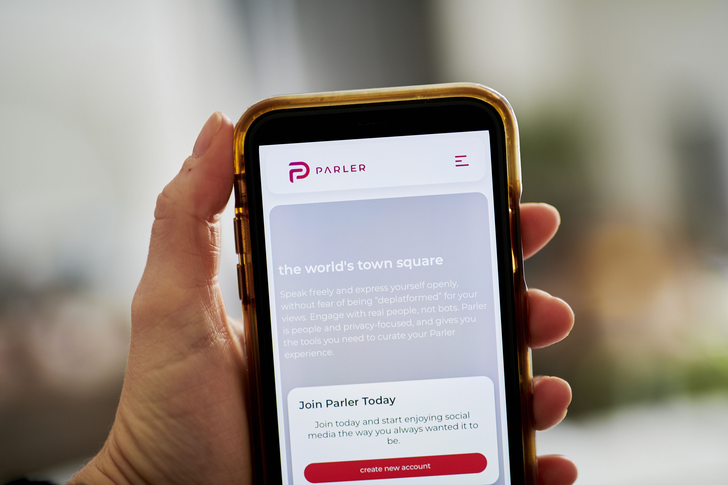 The Parler website is seen on a phone on Friday, December 18, 2020.