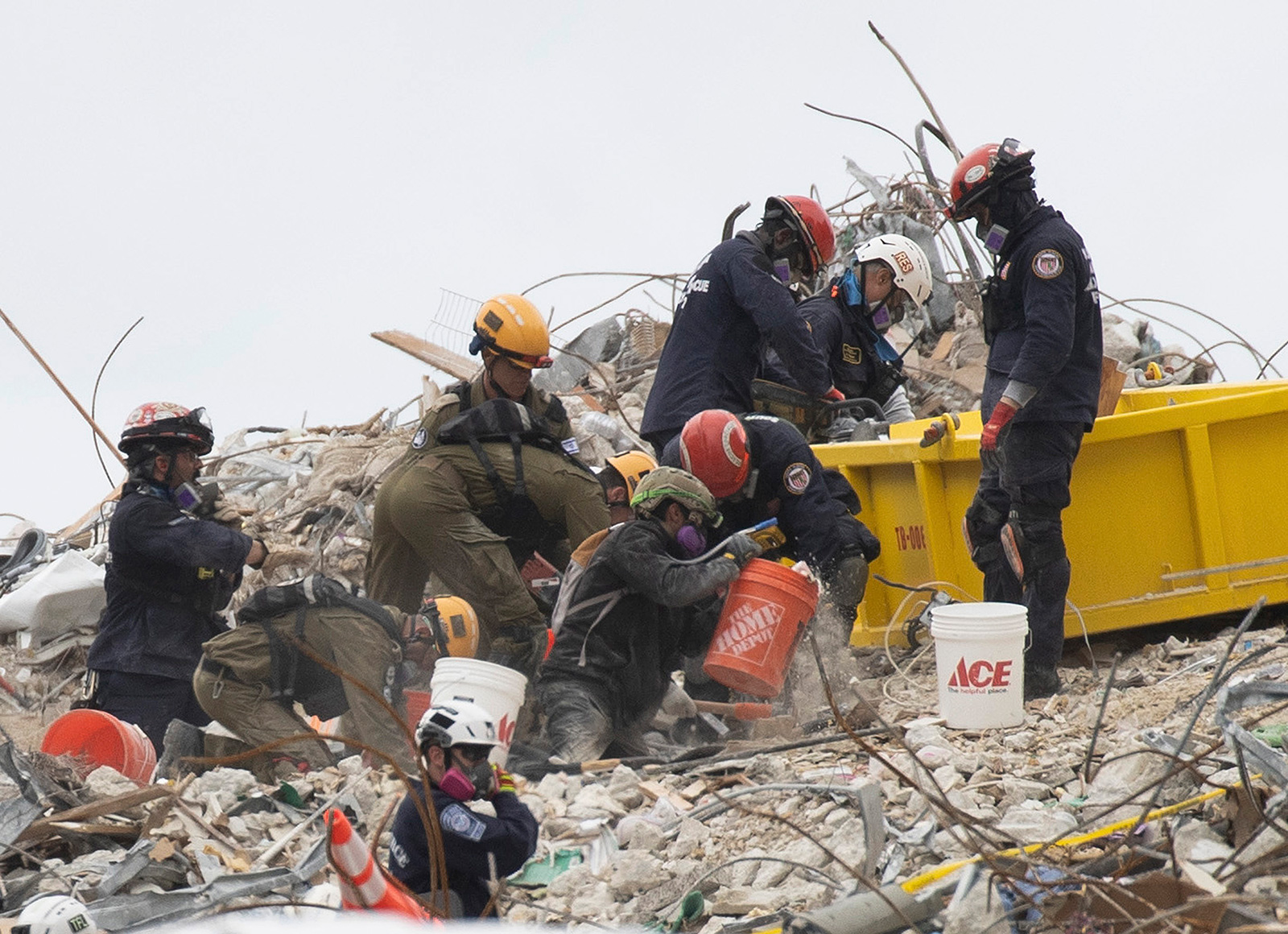 Search and Rescue teams look for possible survivors and to recover remains in the partially collapsed 12-story Champlain Towers South condo building on June 29 in Surfside, Florida.