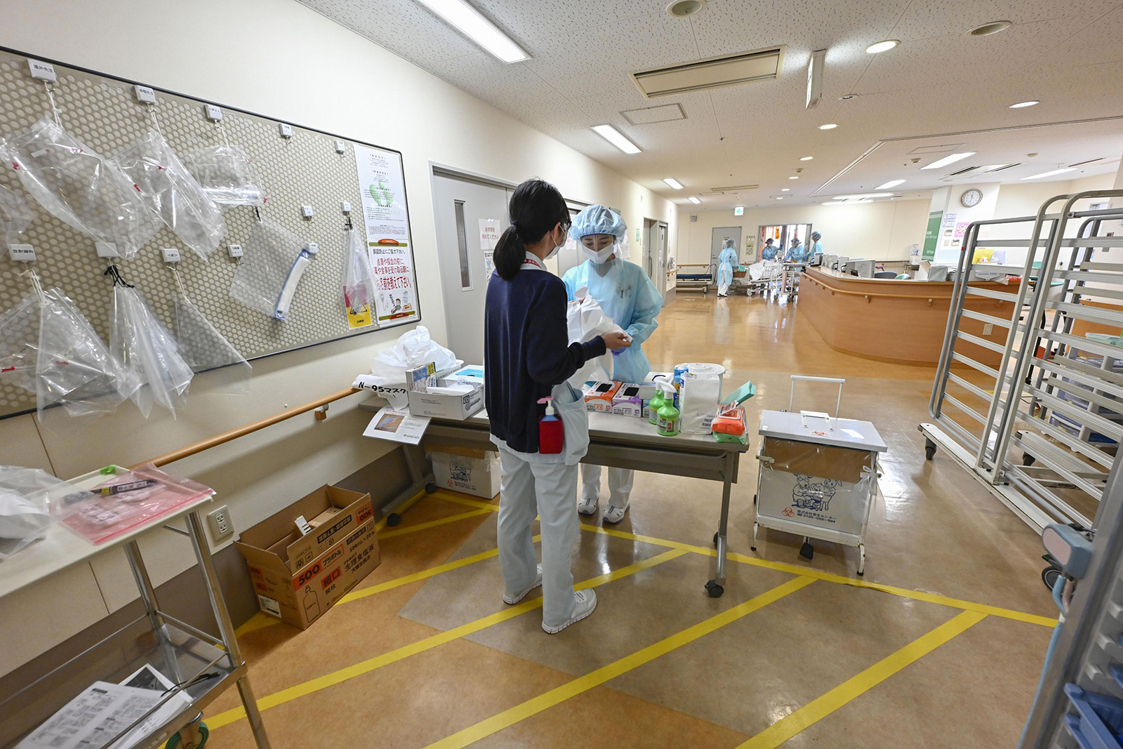 Nurses work in a ward earmarked for coronavirus patients at Kano General Hospital in Osaka, Japan, on February 4.