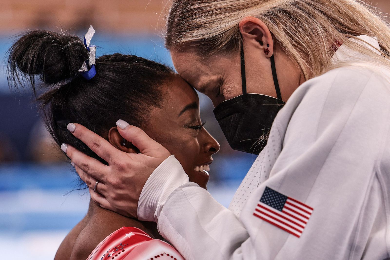 US gymnast Simone Biles is congratulated by coach Cecile Canqueteau-Landi as it became evident that Biles would earn a medal on August 3. Biles now has seven Olympic medals, tying her with Shannon Miller for the most by an American gymnast.