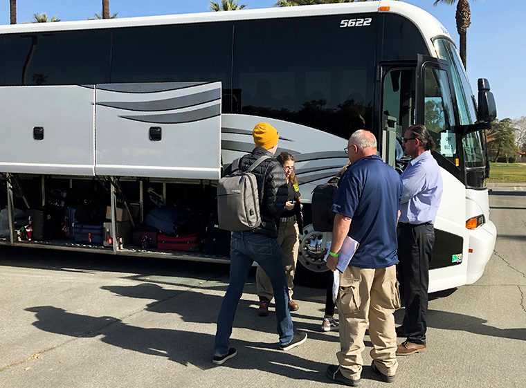 Evacuees are seen preparing to leave March Air Reserve Base in Riverside, California, on Tuesday, February 11, in this photo provided by Riverside University Public Health.