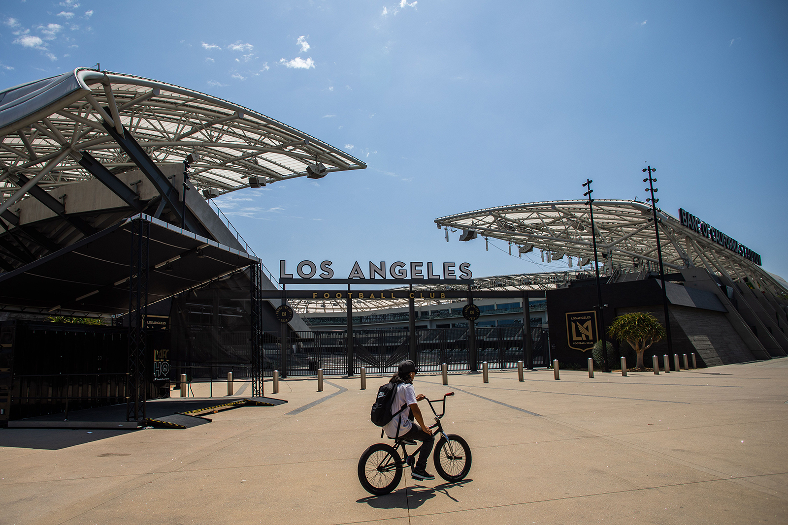 A young man rides his bike in front of the Banc of California Stadium in the neighborhood of Los Angeles on May 9.