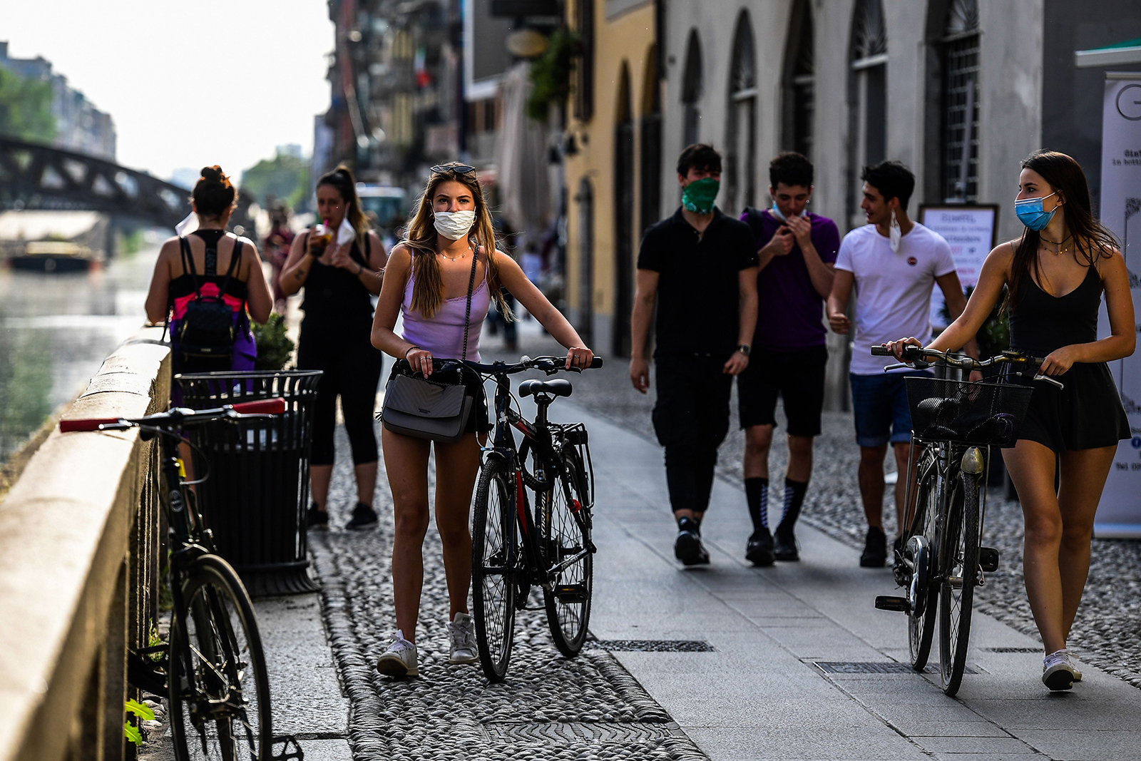 People stroll along the Navigli canals in Milan on May 8.