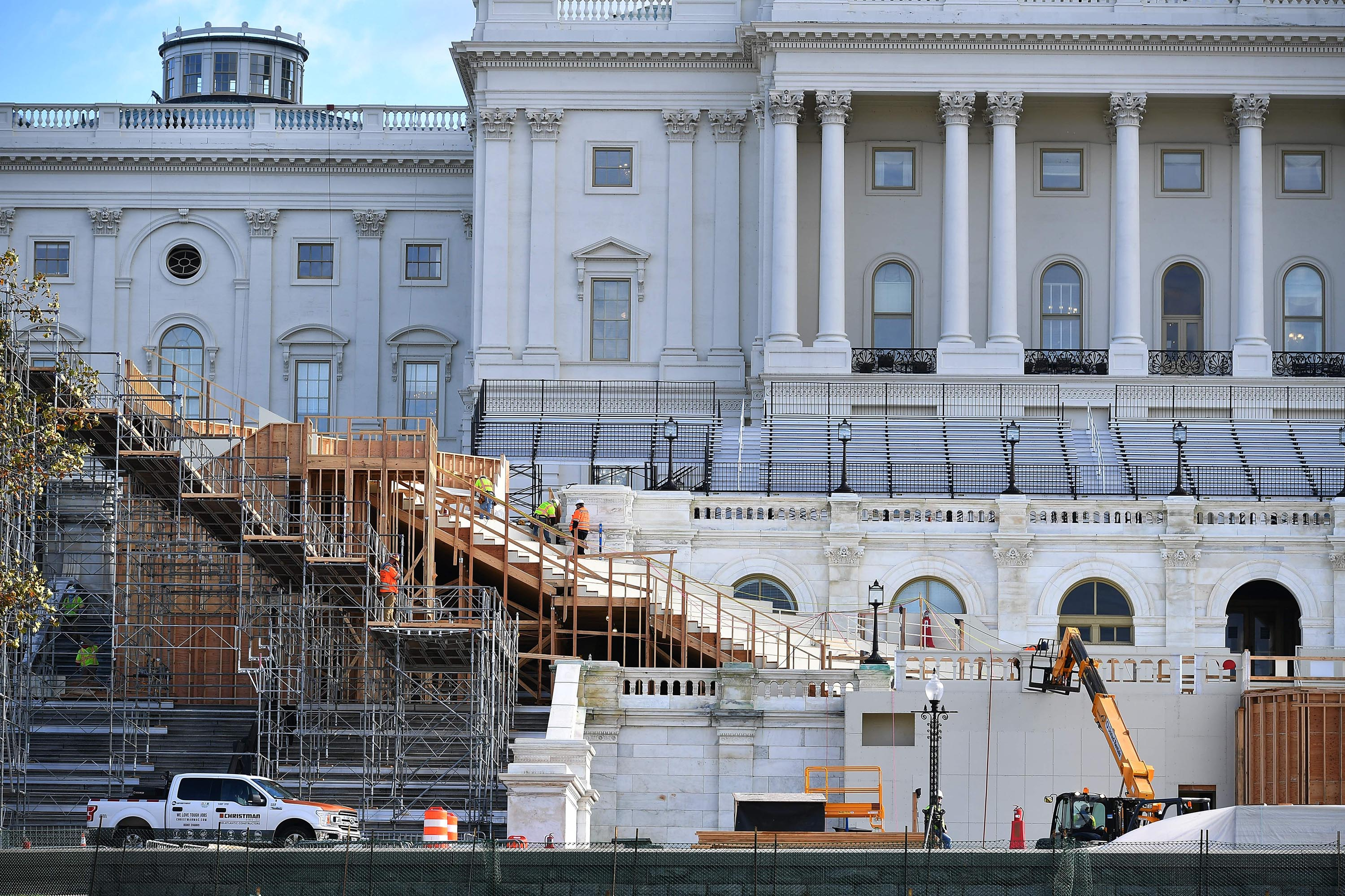Workers construct the stage for the presidential inauguration at the US Capitol in Washington, DC, on December 1, 2020.