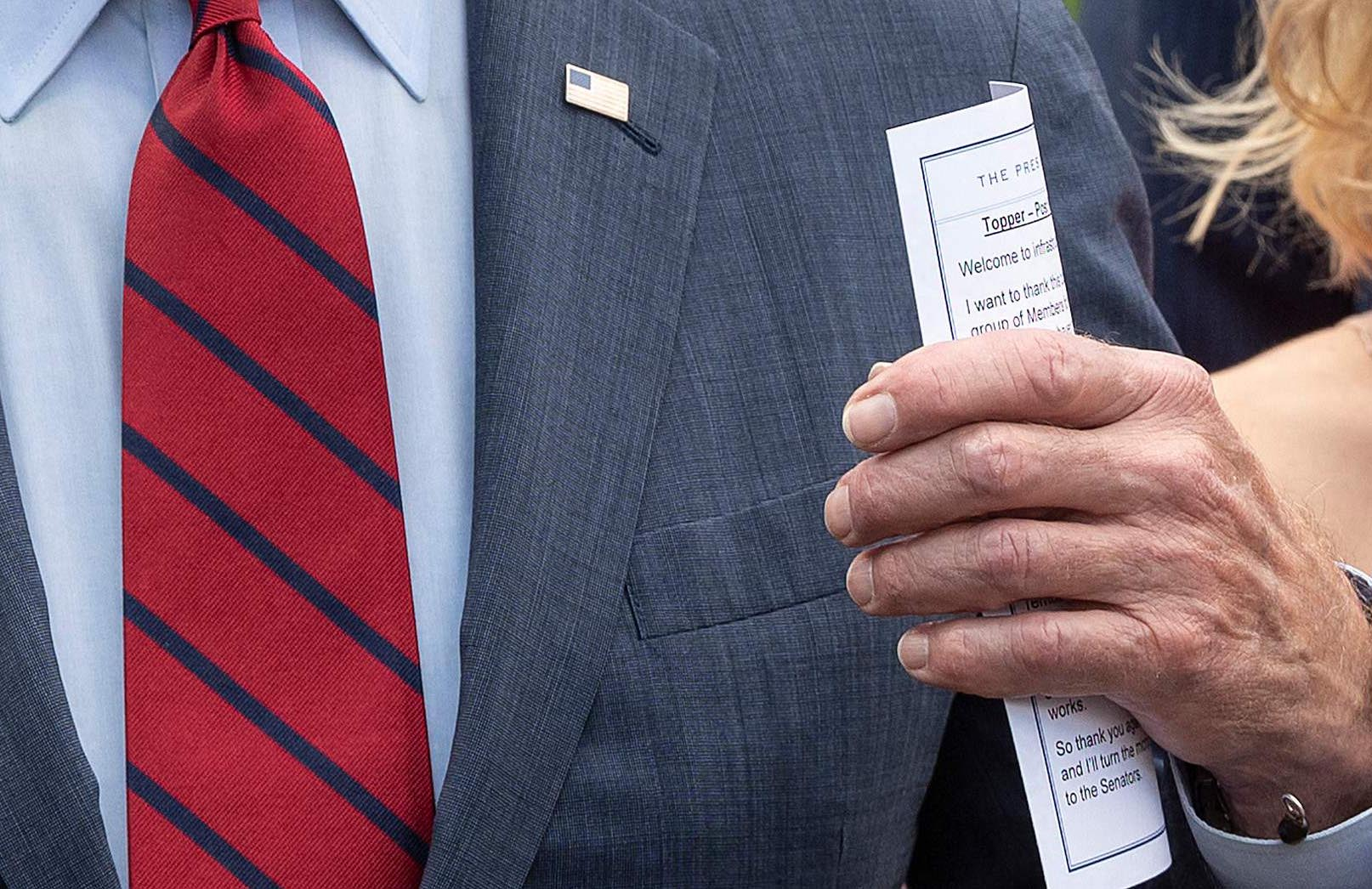 President Joe Biden holds a notecard as he speaks to the media outside the White House after a meeting with a bipartisan group of Senators on infrastructure negotiations on Thursday.