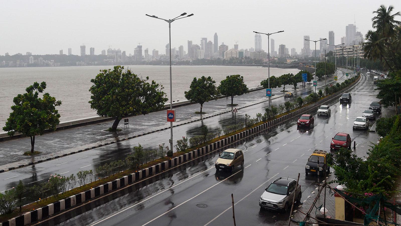 Commuters drive along Marine Drive in Mumbai as Cyclone Nisarga barreled toward India's western coast on Wednesday.