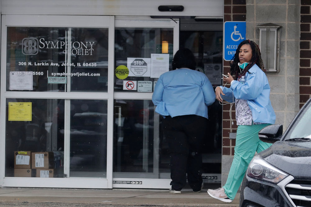 Employees of Symphony of Joliet nursing home go to work at the nursing home in Joliet, Illinois, on Friday, April 17.