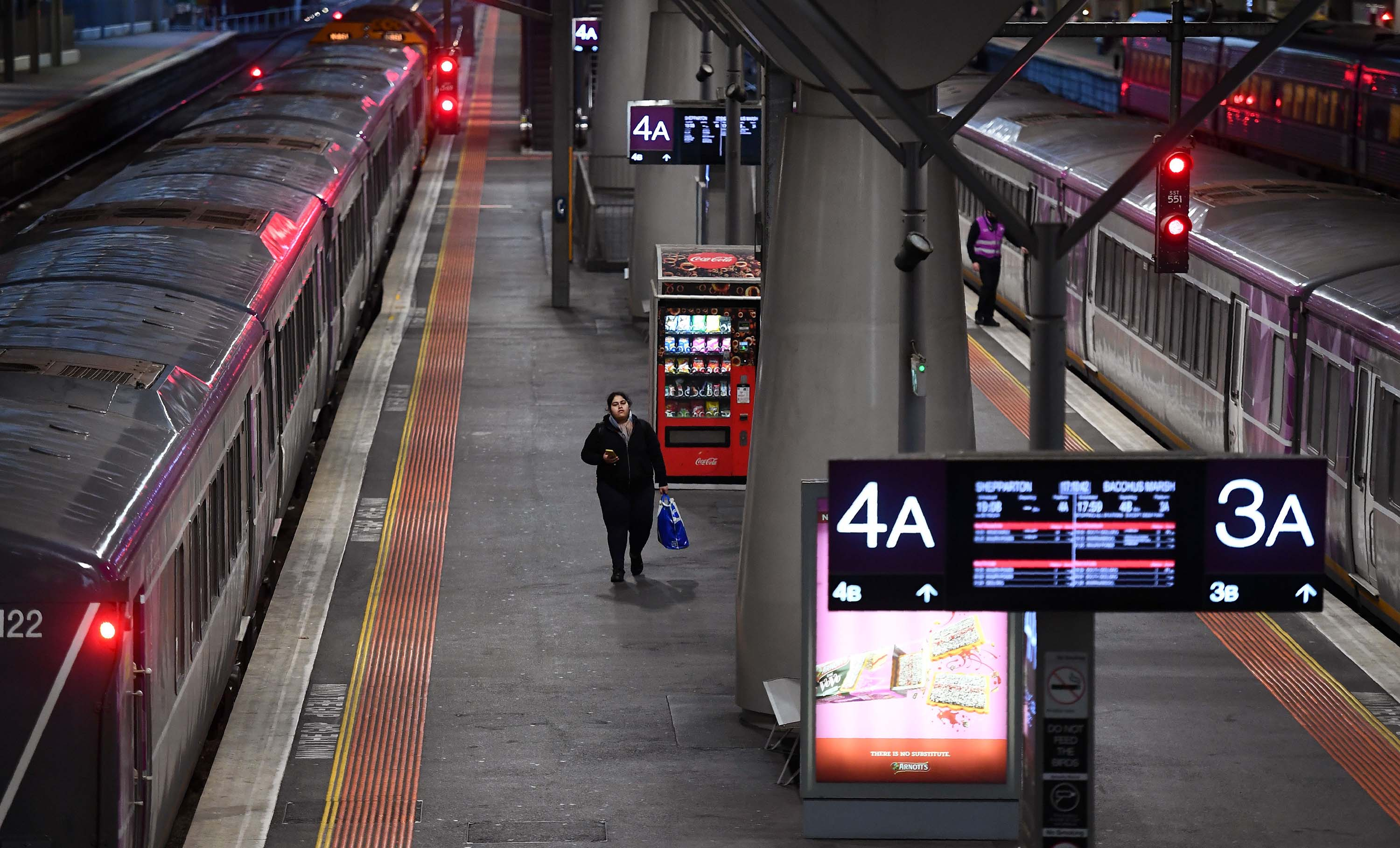 A passenger walks along a platform during rush hour at Melbourne's Southern Cross station on June 30. The Australian state of Victoria has reintroduced lockdown measures on 10 Melbourne suburbs following a recent spike in coronavirus cases.