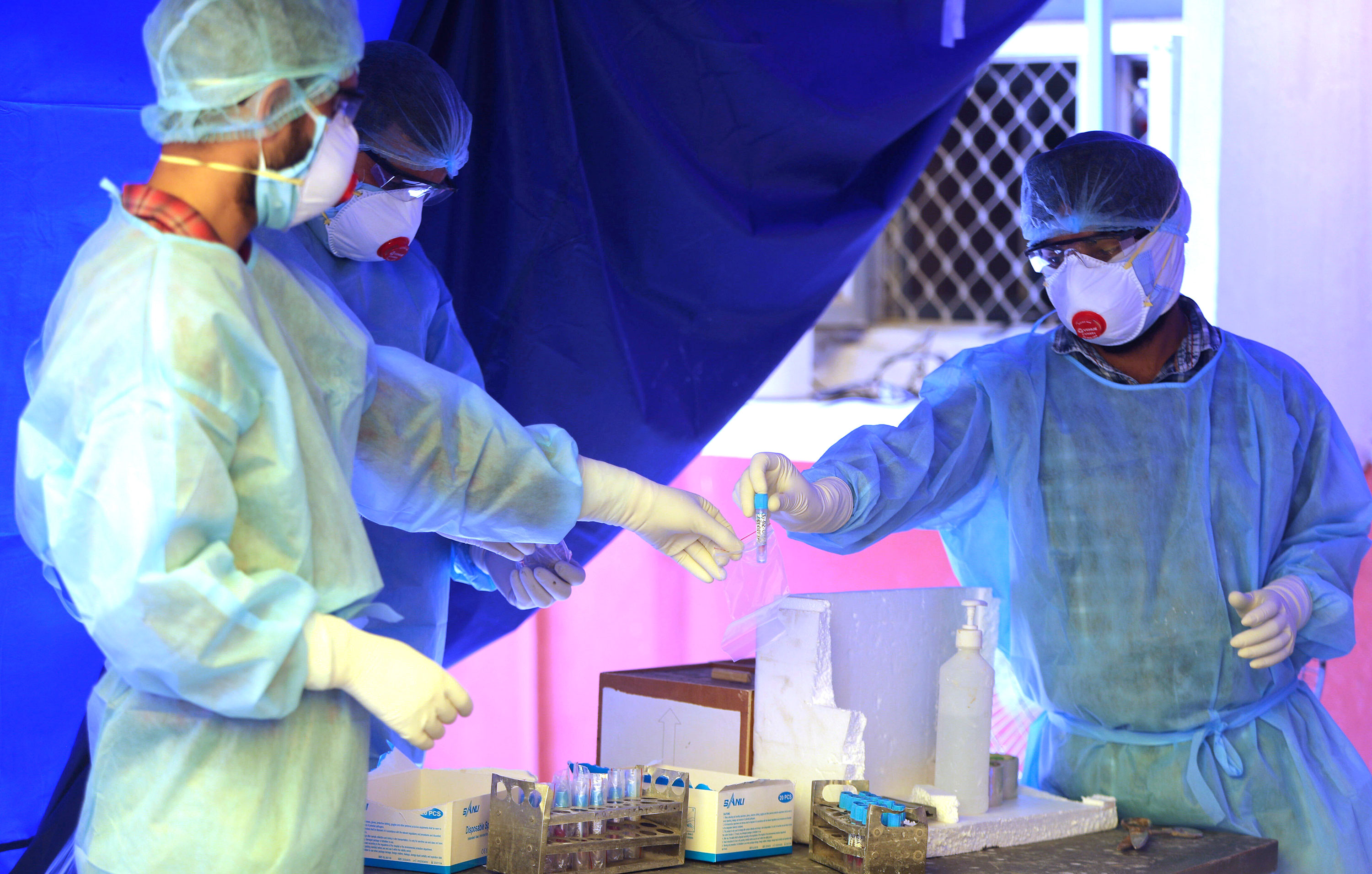 Health workers conduct coronavirus tests at a hospital in Jammu, India, on May 18.