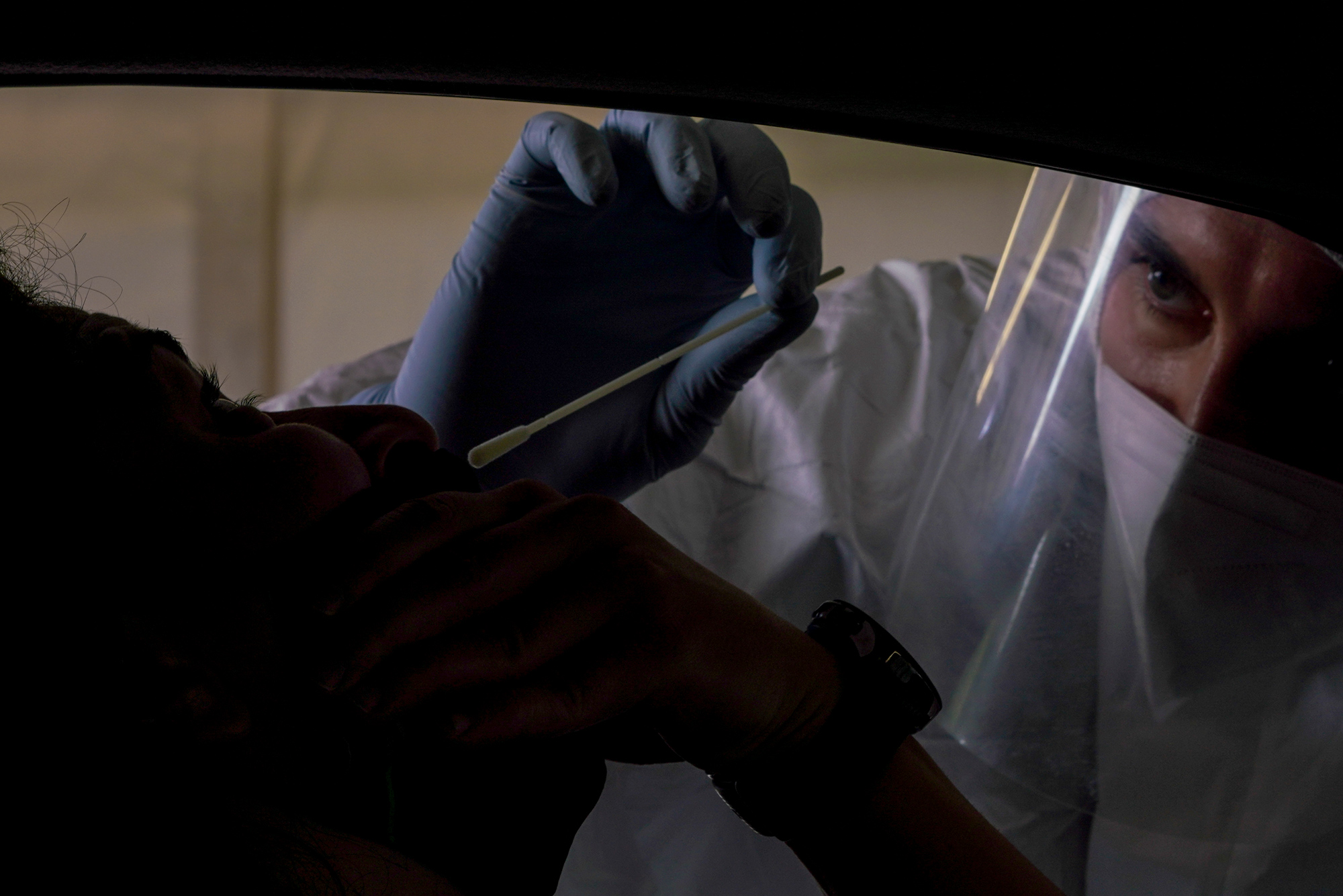 A medical staffer performs swabs to test for coronavirus in the Military barracks of Cecchignola in Rome on October 27.