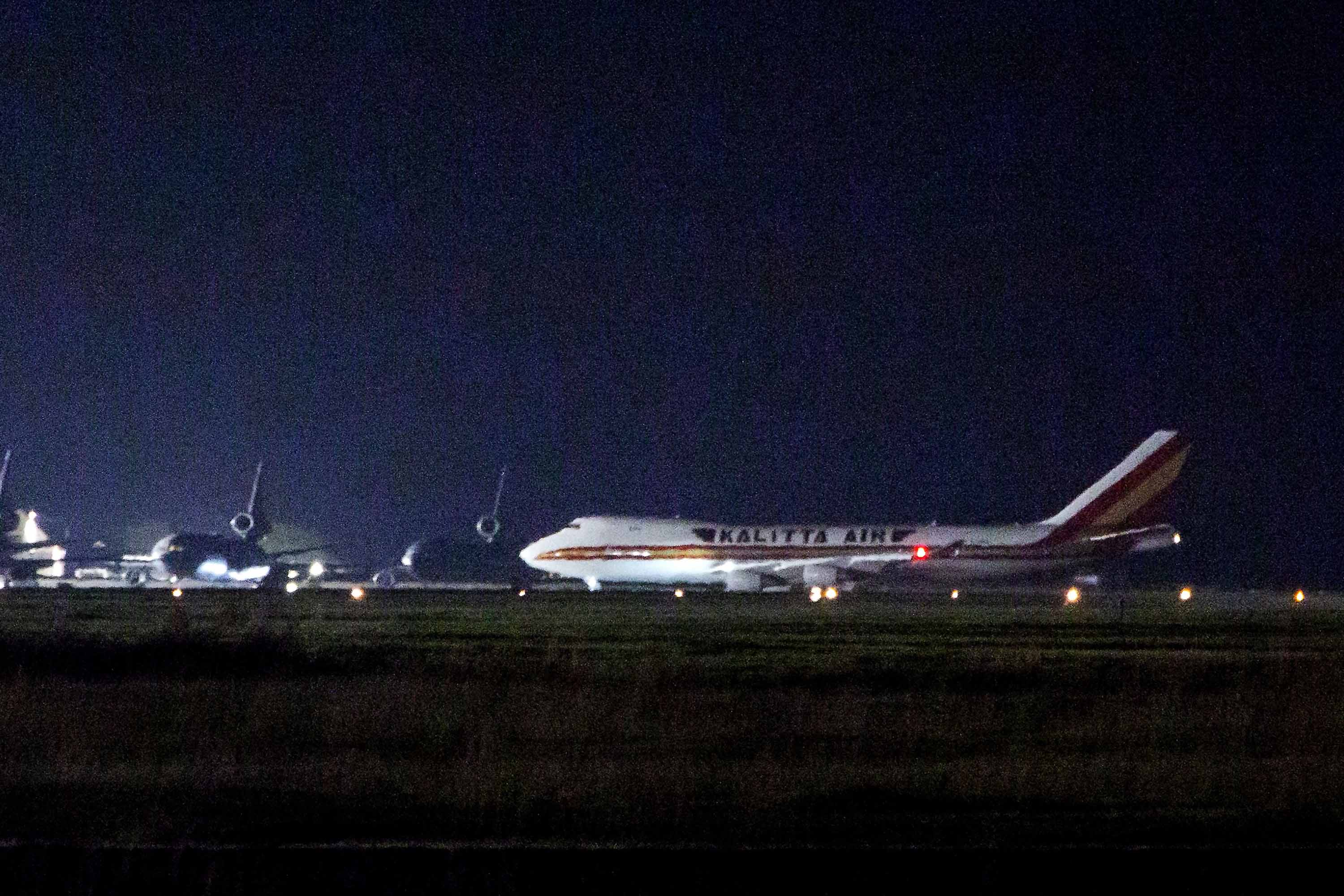 A plane carrying American passengers, who were released from quarantine aboard the Diamond Princess cruise ship in Japan, arrives at Travis Air Force Base in California on February 16.