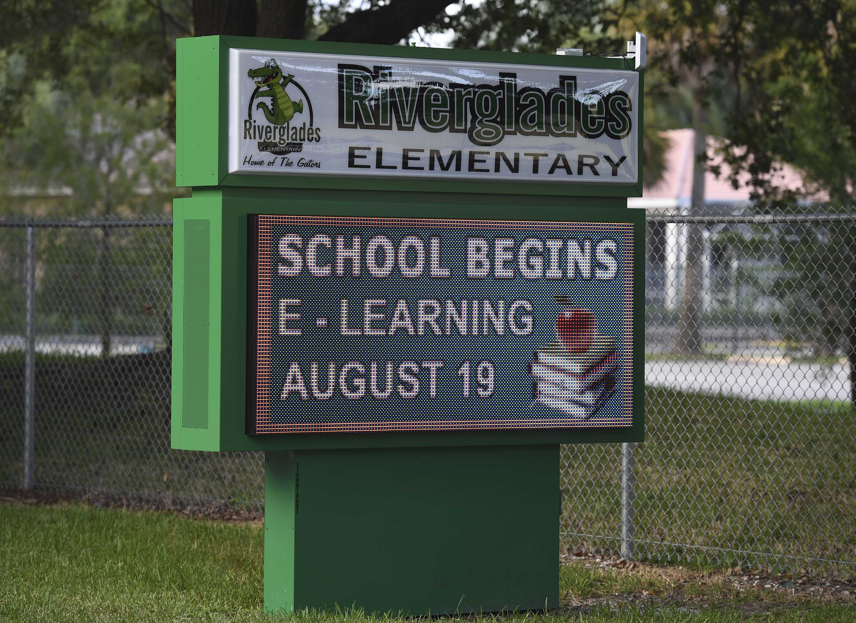 A sign with information about 'eLearning' is pictured outside Riverglades Elementary School in Pompano Beach, Florida, on August 11.