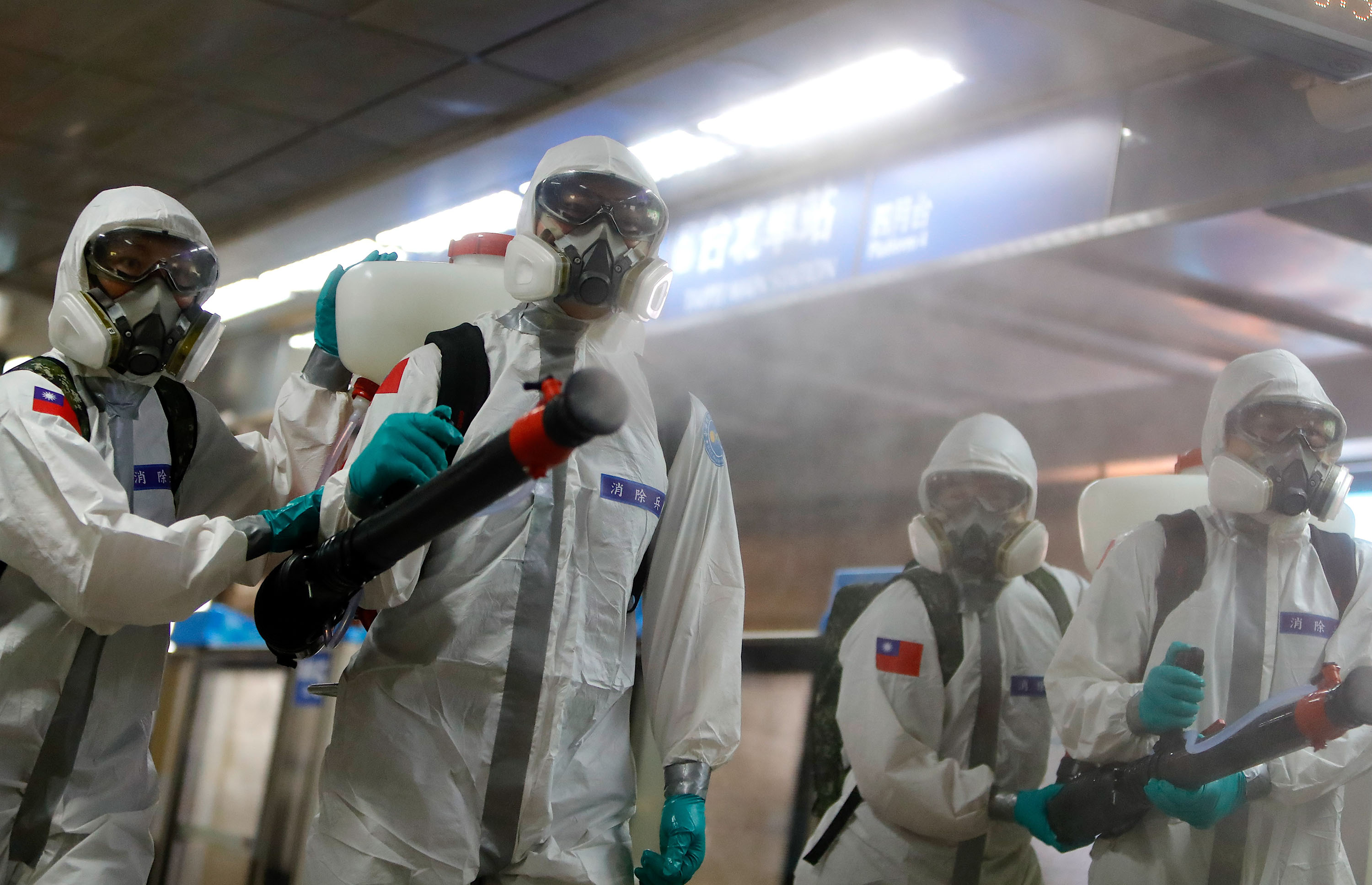 Military officers disinfect a subway station in Taipei, Taiwan on Tuesday, May 18.