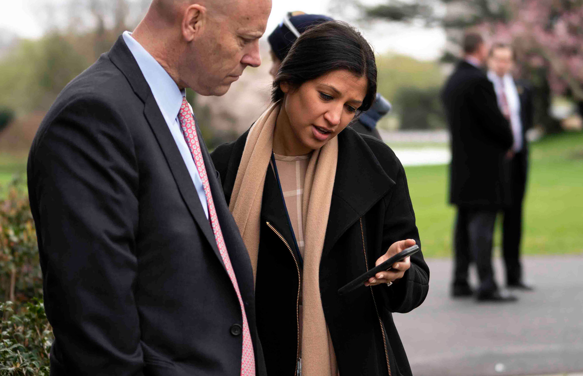 Katie Miller, Vice President Mike Pence's press secretary, speaks with Marc Short, Chief of Staff for Vice President Mike Pence, in the Rose Garden of the White House on March 24, in Washington.