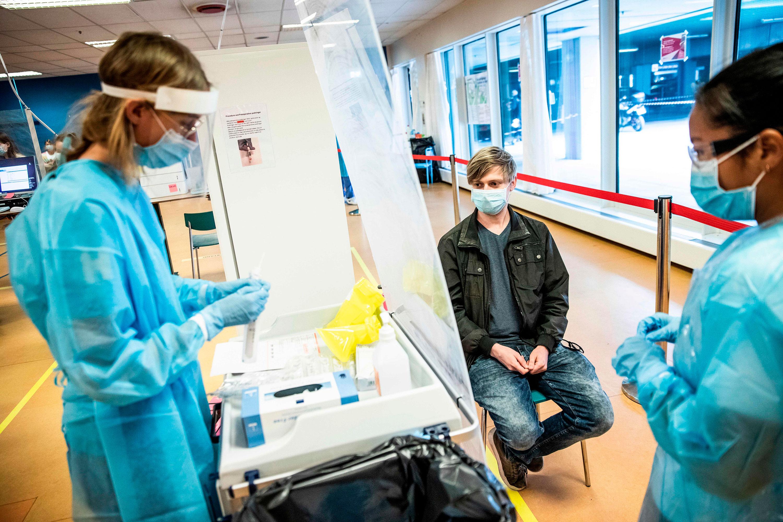 Medical staff members prepare a coronavirus test swab on May 6 at Herlev Hospital, Copenhagen, Denmark.