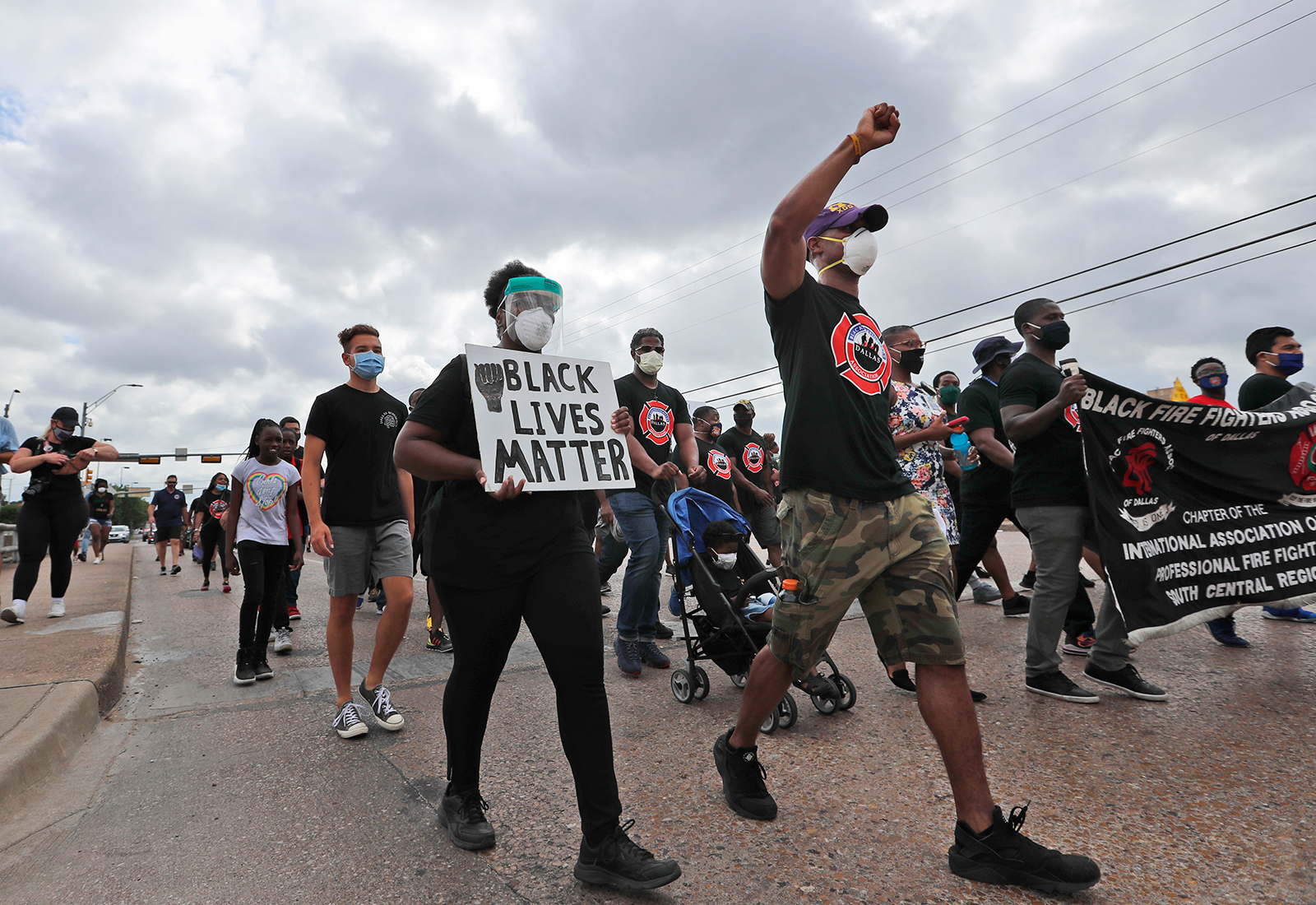 Protesters march in a Black Lives Matter demonstration organized by the Dallas Black Firefighters Association on Juneteenth 2020 in Dallas.
