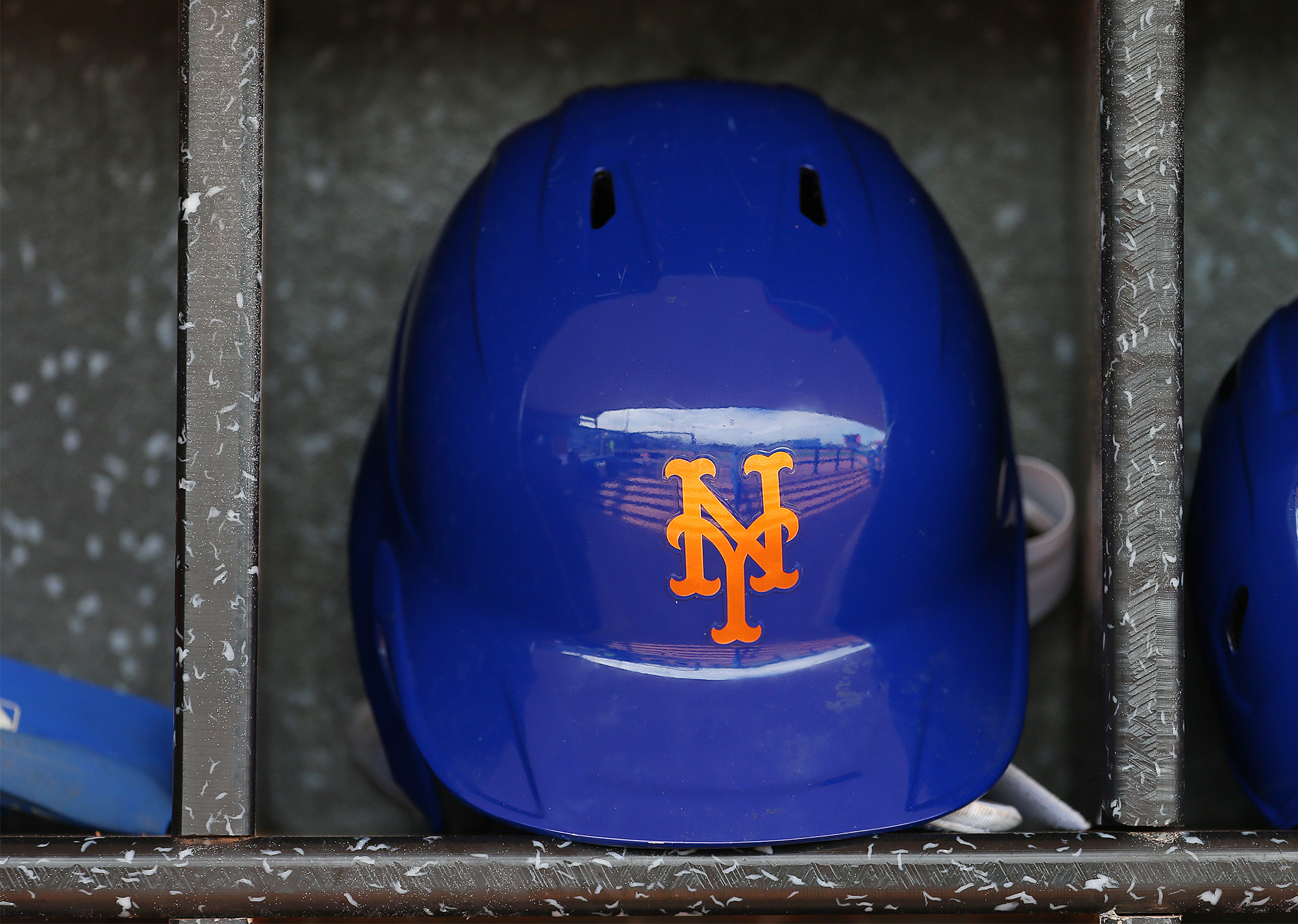 A New York Mets batting helmet in the dugout before a spring training baseball game at Clover Park on March 8, in Port St. Lucie, Florida.
