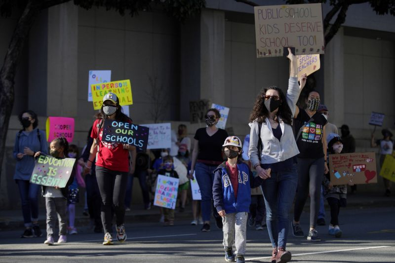 Hundreds of people march to City Hall in San Francisco, California, on February 6 to demand schools reopen in-person education.