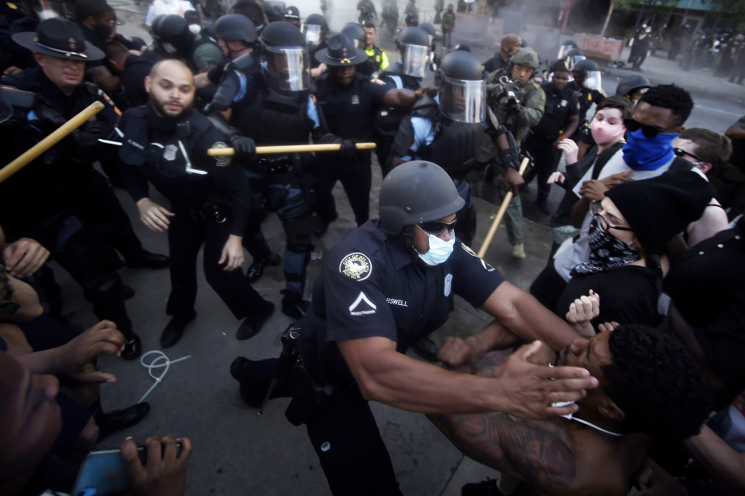 Police officers and protesters clash near CNN center in Atlanta, Georgia, on Friday, May 29.
