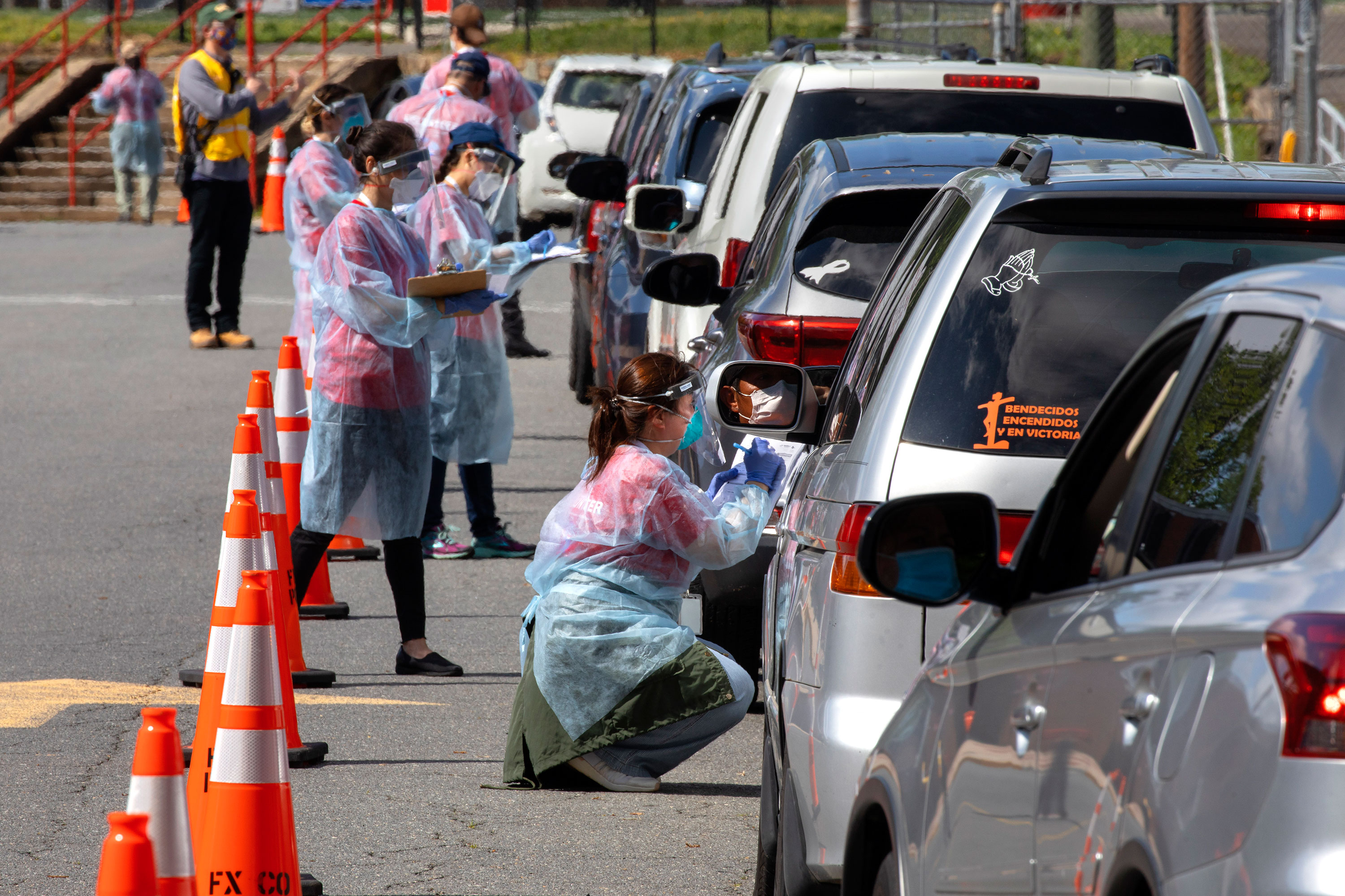People wait in line to be tested for coronavirus on May 23 in Annandale, Virginia.