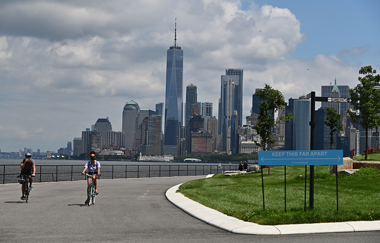 People ride bikes as they visit Governors Island on July 15, 2020 in New York City.