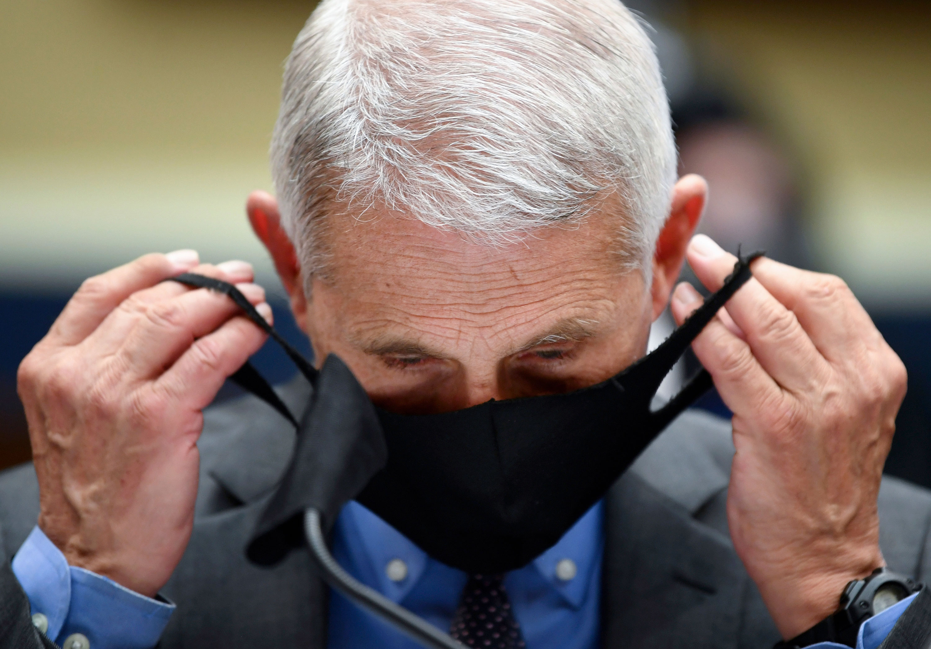 Dr. Anthony Fauci removes his face mask before testifying at a hearing on the Trump administration's response to the Covid-19 pandemic on June 23 in Washington.