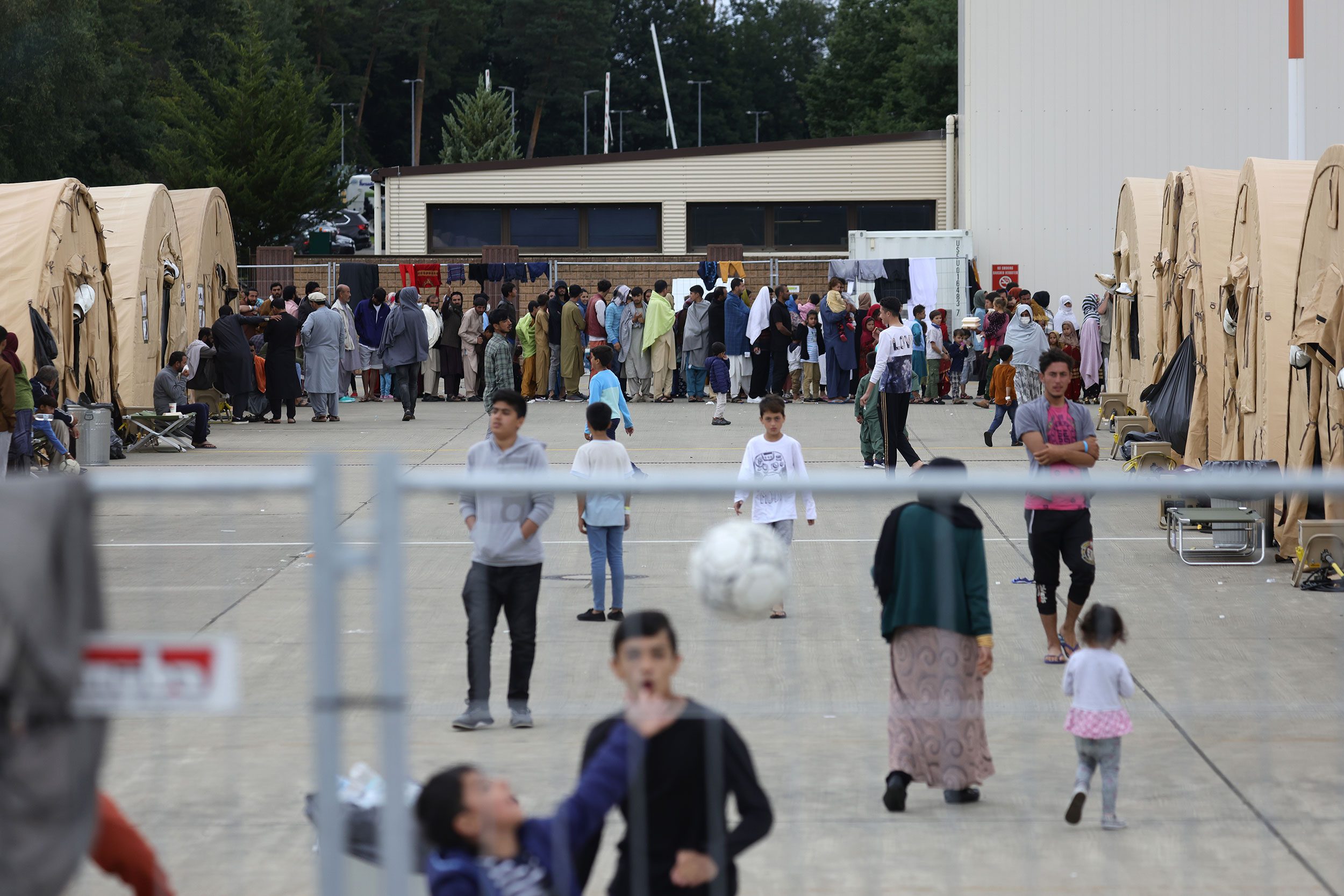 Evacuees walk around a temporary shelter at Ramstein Air Base in Germany on August 26.