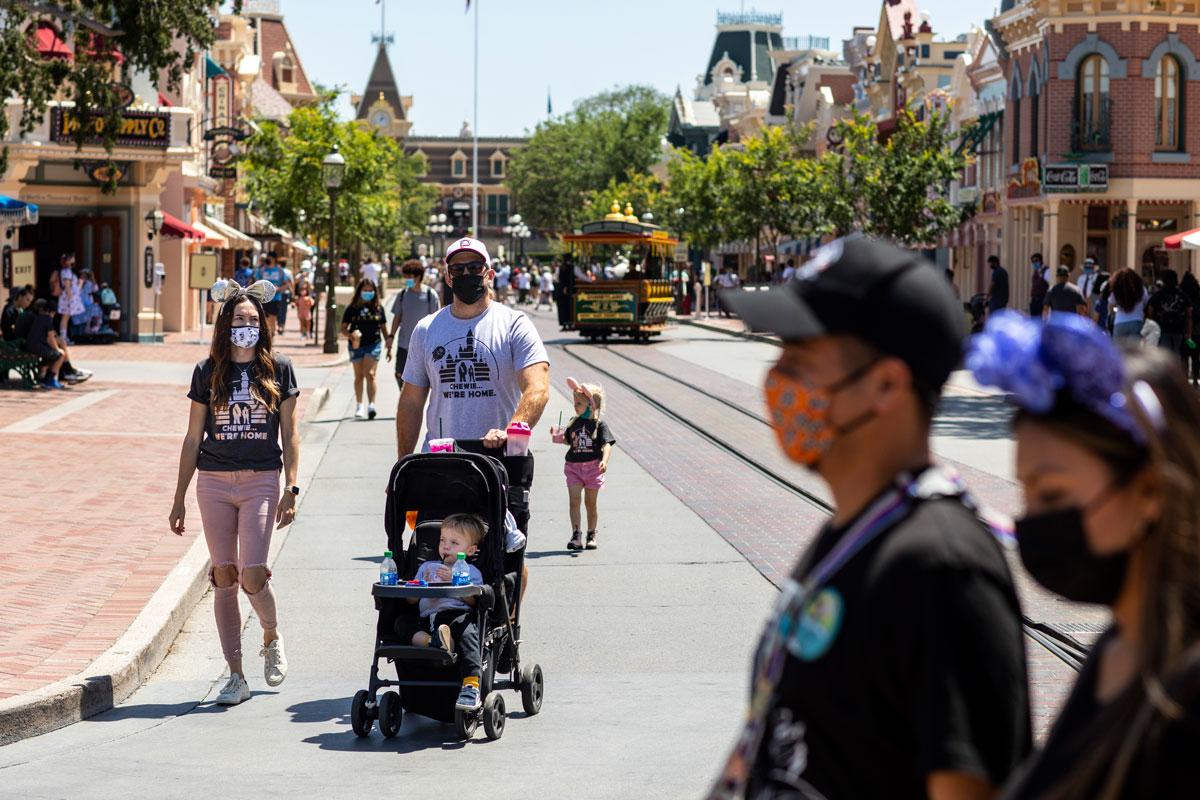 Vistors wear masks at Disneyland Resort in Anaheim, CA on May 3.