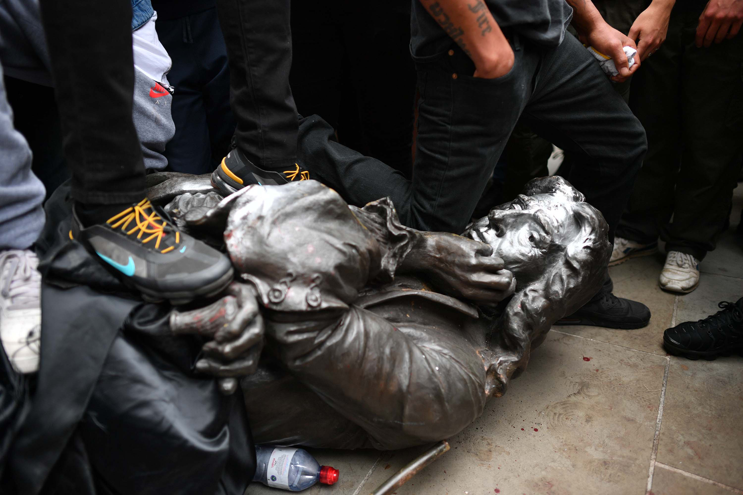 Protesters pull down a statue of 17th-century slave trader Edward Colston during a Black Lives Matter rally in Bristol, England, on June 7.