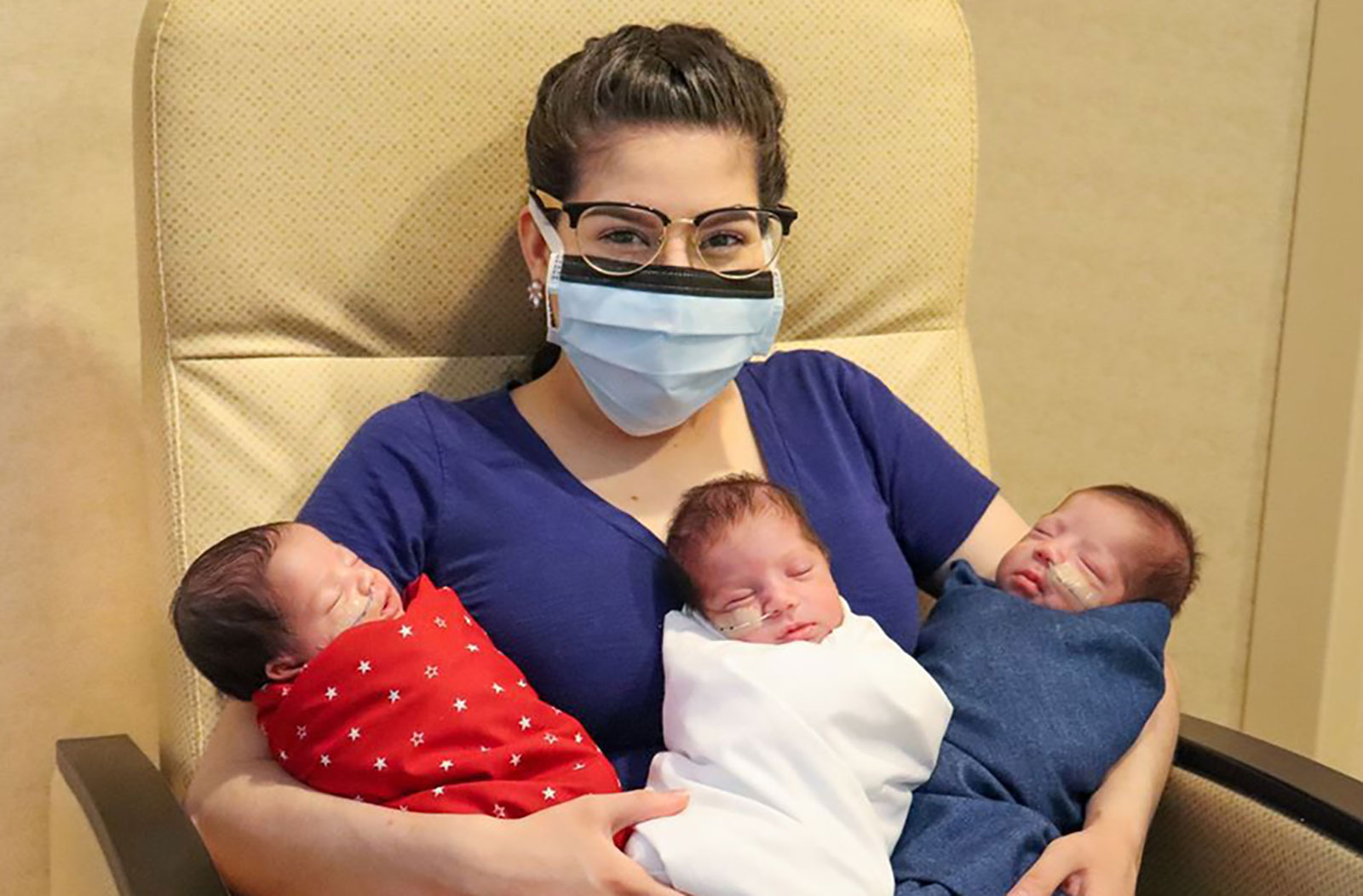 Maggie Sillero holds her triplets, who were born on June 4 after she beat Covid-19.